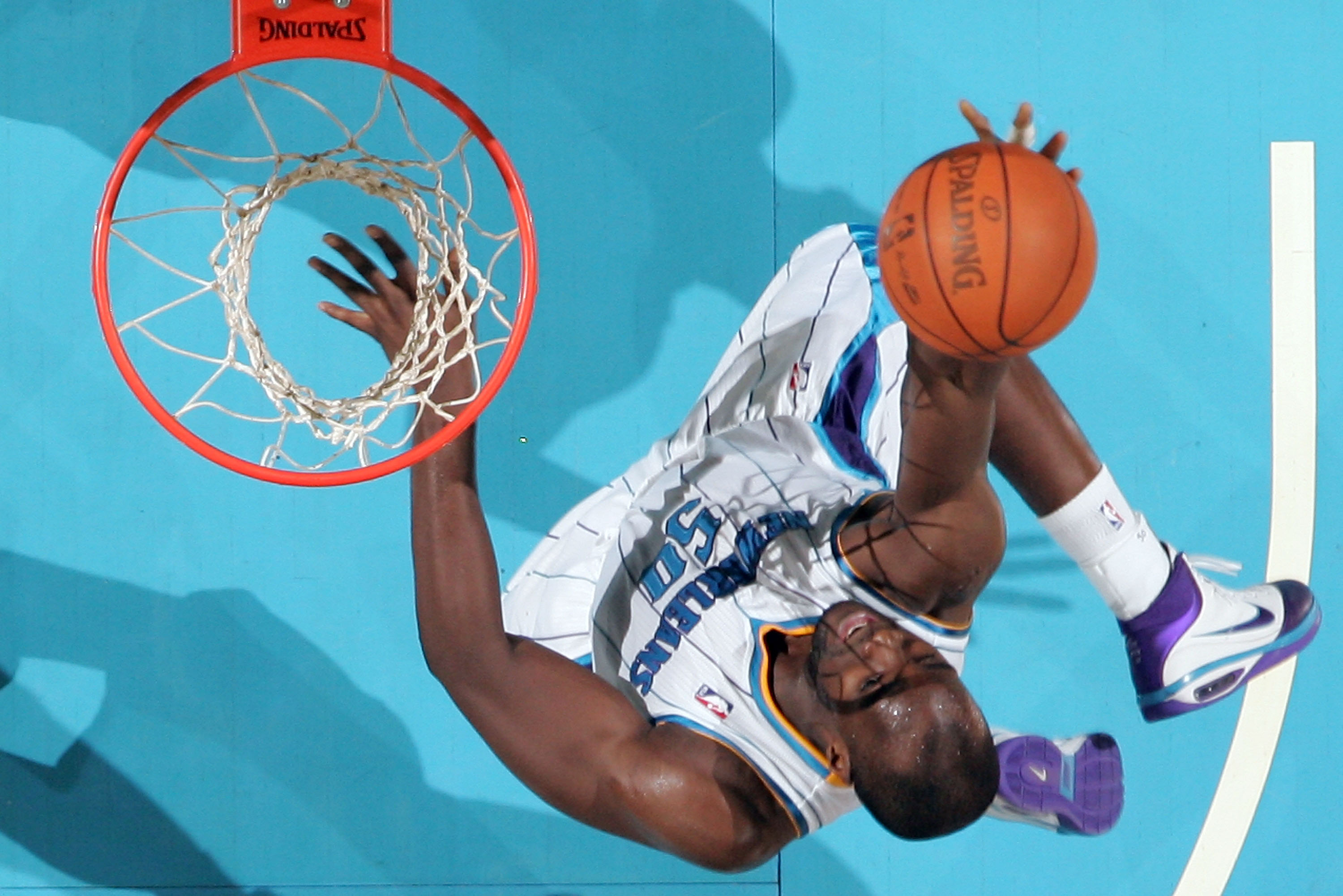 NEW ORLEANS - NOVEMBER 28:  Emeka Okafor #50 of the New Orleans Hornets makes a layup during the game against the San Antonio Spurs at the New Orleans Arena on November 28, 2010 in New Orleans, Louisiana.  NOTE TO USER: User expressly acknowledges and agr