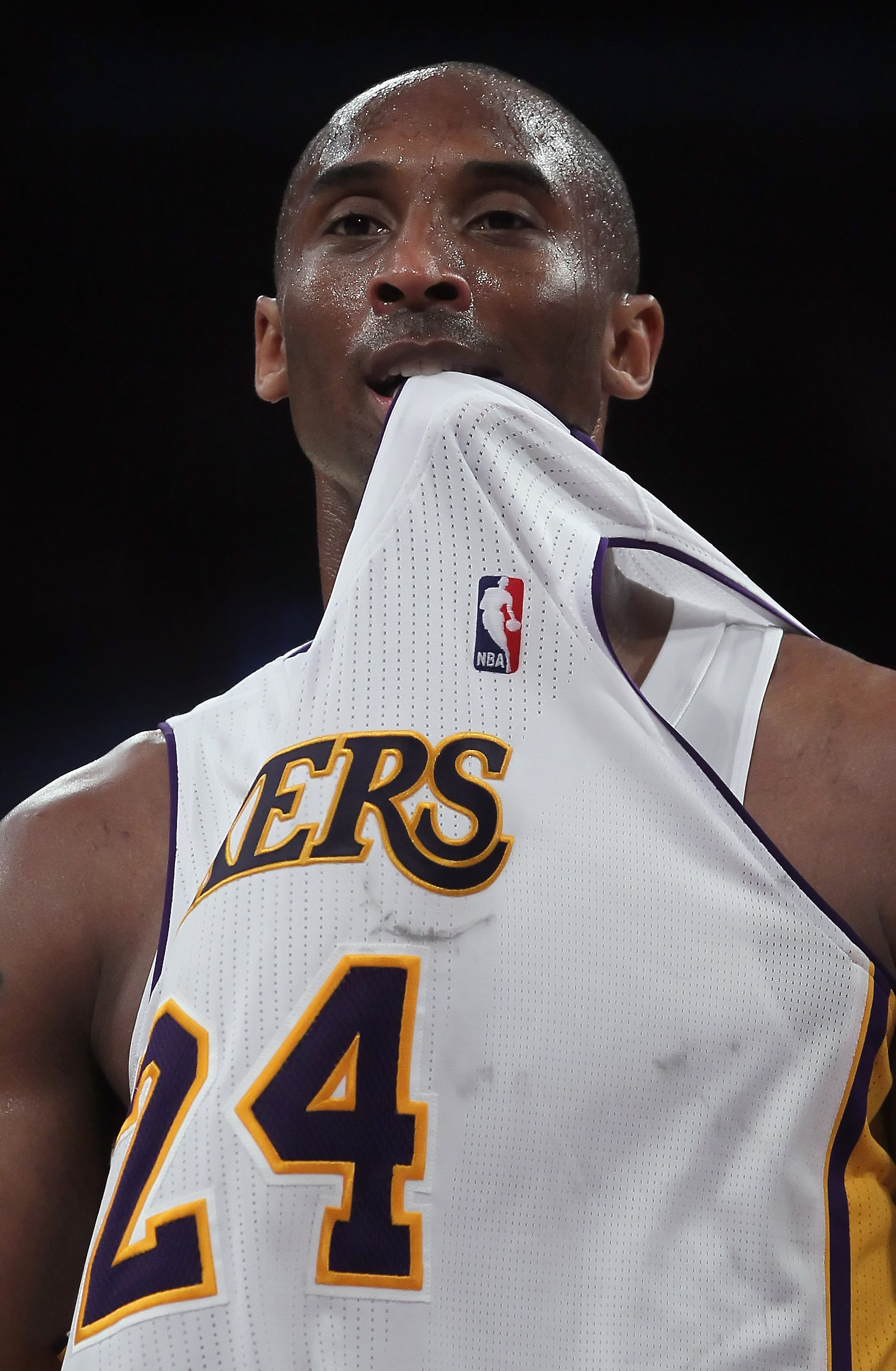 LOS ANGELES, CA - APRIL 10:  Kobe Bryant #24 of the Los Angeles Lakers puts his jersey in his mouth after committing a foul in the second half against the Oklahoma City Thunder at Staples Center on April 10, 2011 in Los Angeles, California. The Thunder de