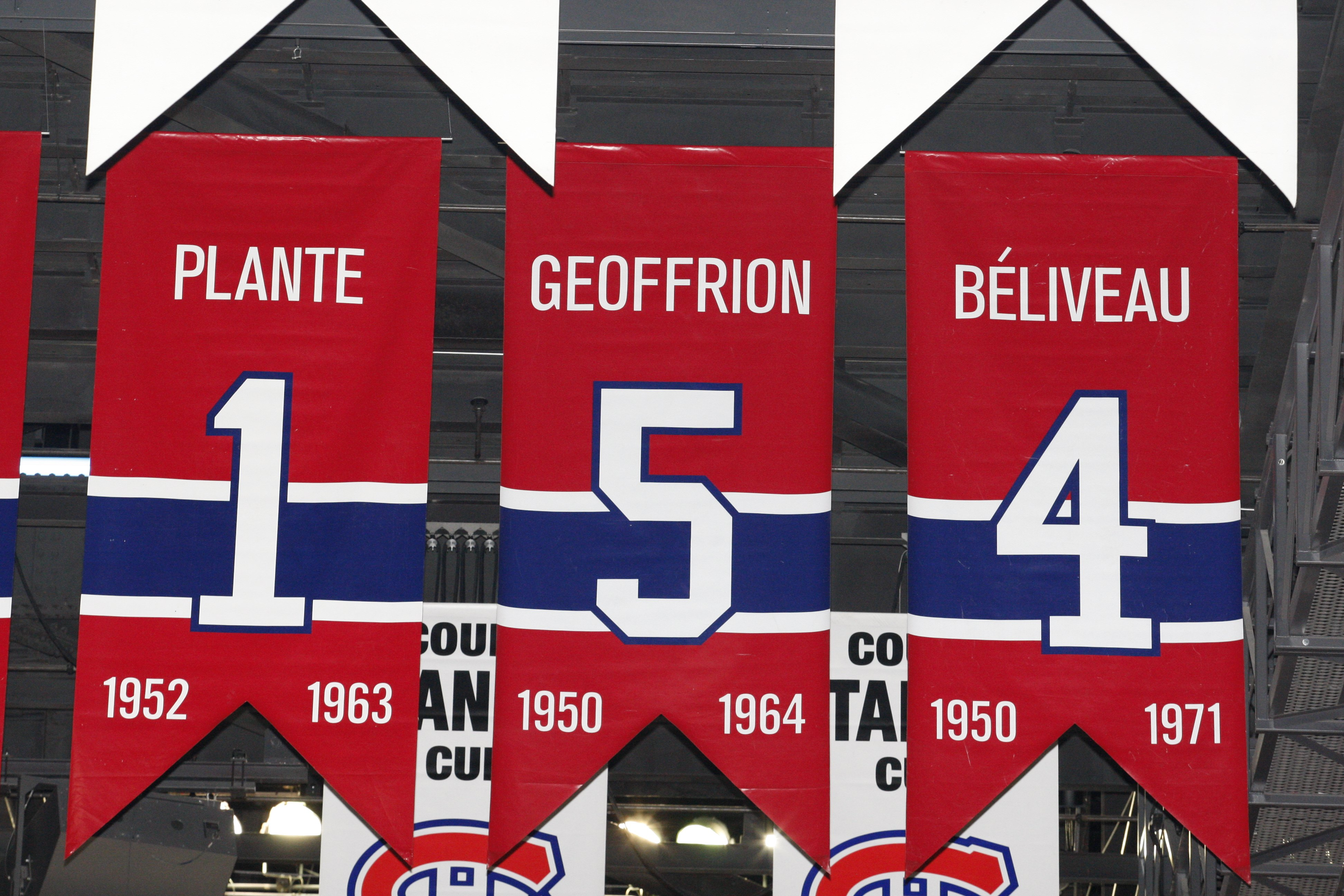 MONTREAL- APRIL 19:  A photo of the banners commemorating the retired jerseys of Jacque Plante, Bernard Geoffrion and Jean Beliveau hanging in the Bell Centre prior to Game Three of the Eastern Conference Quarterfinals between the Washington Capitals and
