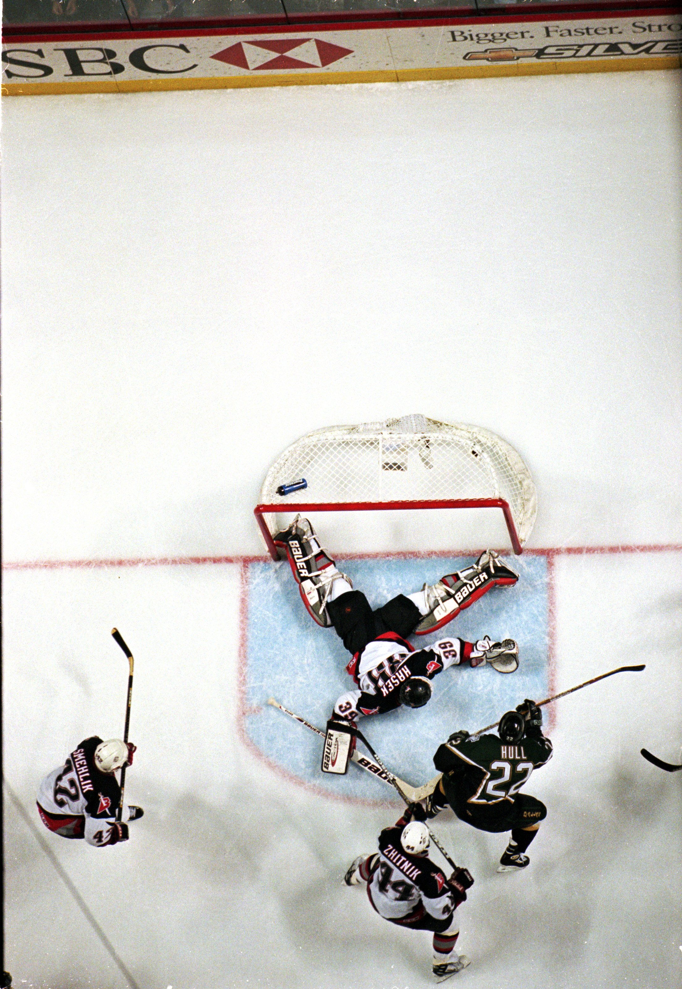 19 Jun 1999:  Goalie Dominik Hasek #39 of the Buffalo Sabres misses the final puck which was shot by Brett Hull #22 of the Dallas Stars during the Stanley Cup Finals game at the Marine Midland Arena in Buffalo, New York. The Dallas Stars defeated the Sabr
