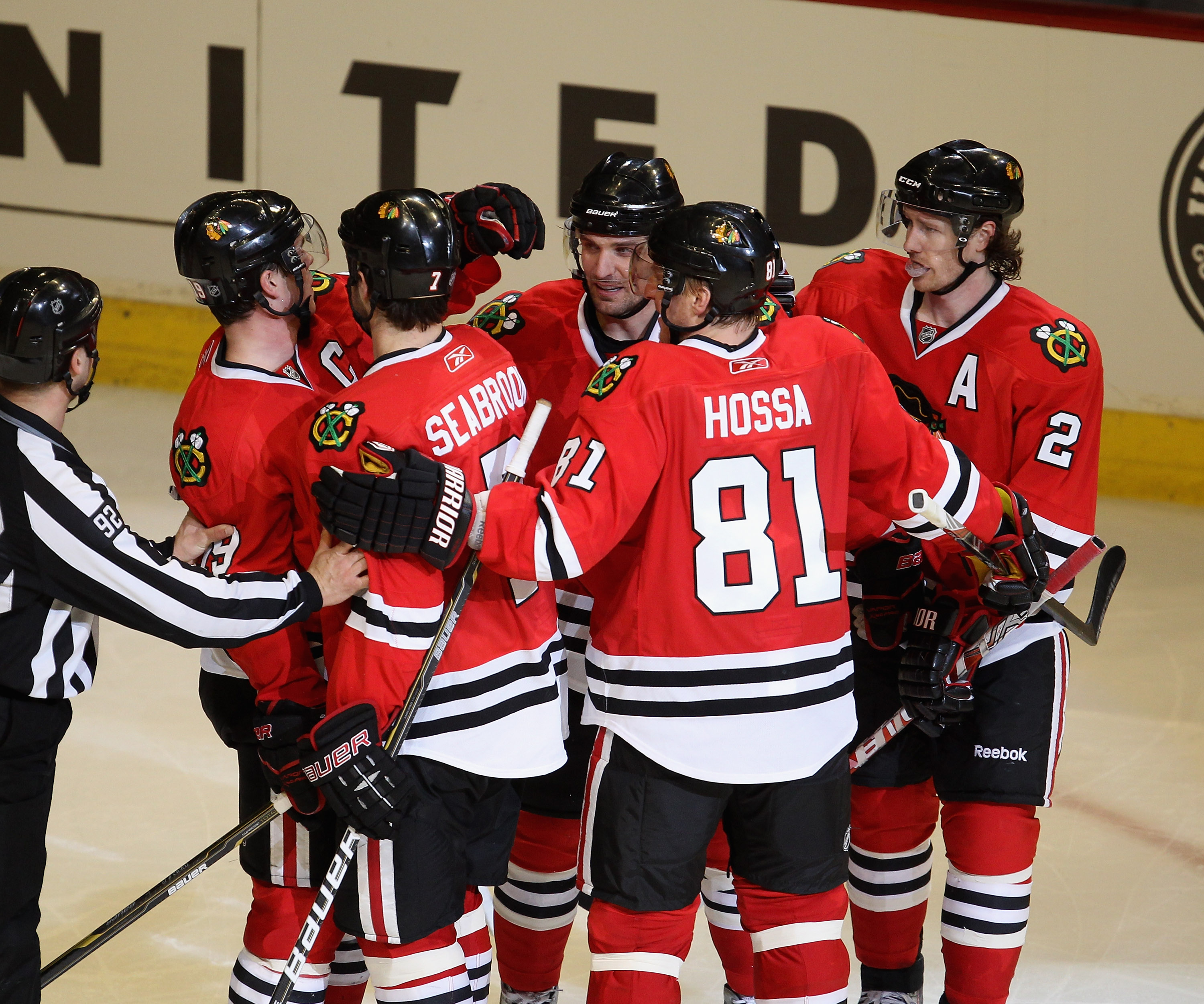 CHICAGO, IL - APRIL 10: (L-R) Jonathan Toews #19, Brent Seabrook #7, Patrick Sharp #10, Marian Hossa #81 and Duncan Keith #2 of the Chicago Blackhawks celebrate keiths' 3rd period goal against the Detroit Red Wings at the United Center on April 10, 2011 i