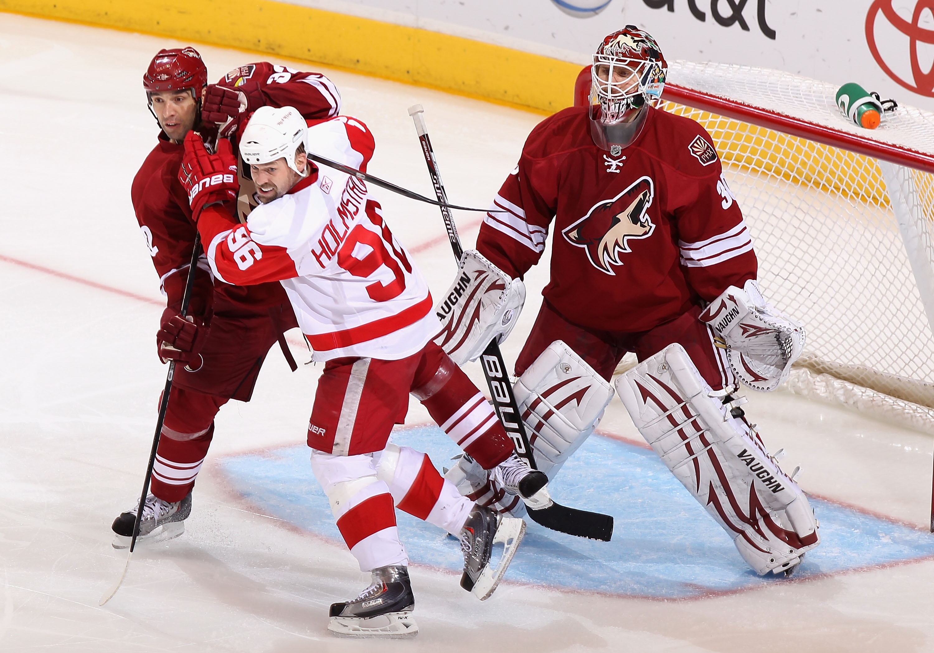 GLENDALE, AZ - MARCH 05:  Tomas Holmstrom #96 of the Detroit Red Wings sets up in front of goaltender Ilya Bryzgalov #30 of the Phoenix Coyotes during the NHL game at Jobing.com Arena on March 5, 2011 in Glendale, Arizona. The Coyotes defeated the Red Win