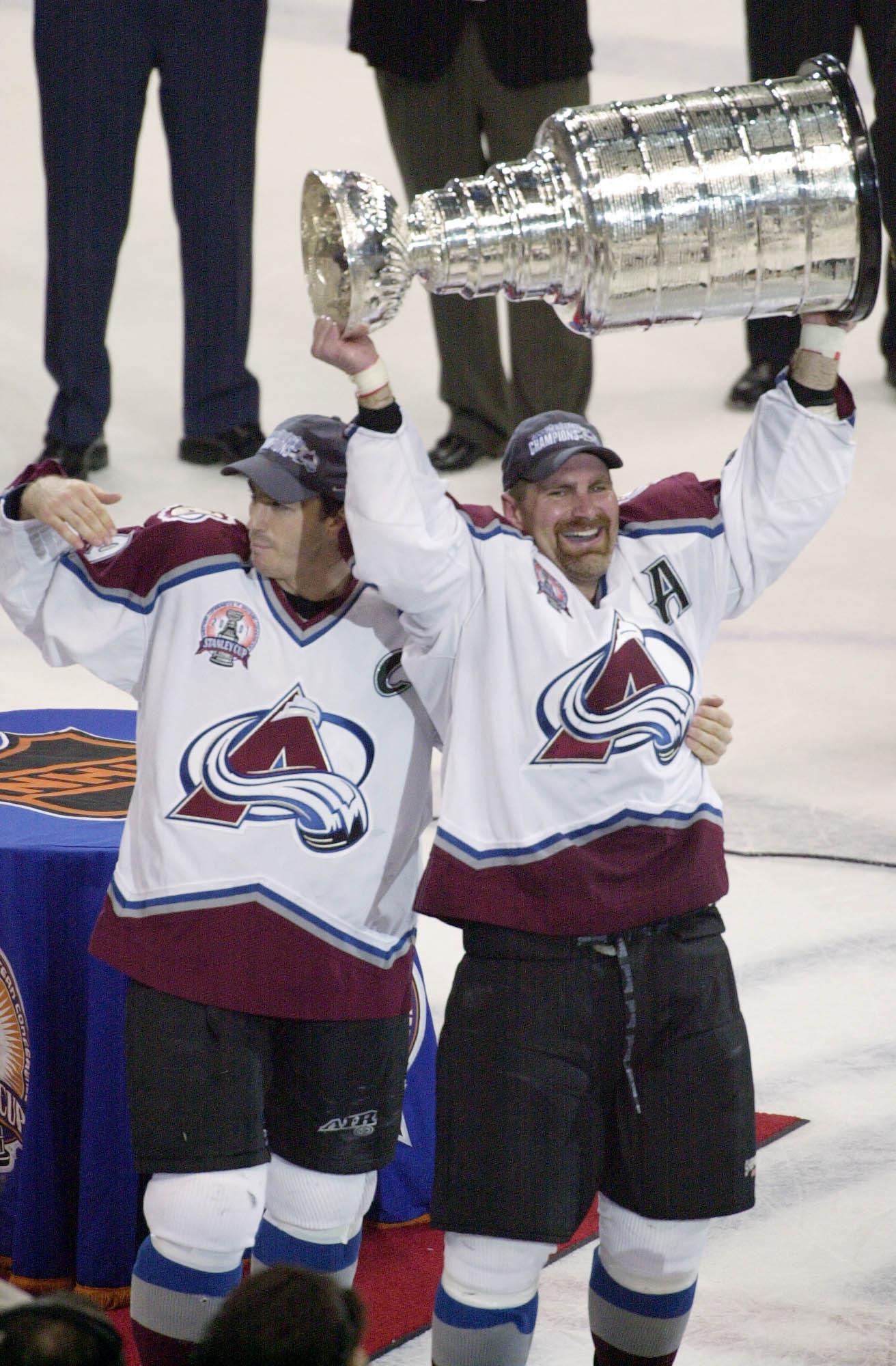 9 Jun 2001:  Joe Sakic #19 and Ray Borque #77  (right) of the Colorado Avalanche hold up the Stanley Cup after defeating the New Jersey Devils in game seven of the NHL Stanley Cup Finals at Pepsi Center in Denver, Colorado.  The Avalanche won 3-1 to take