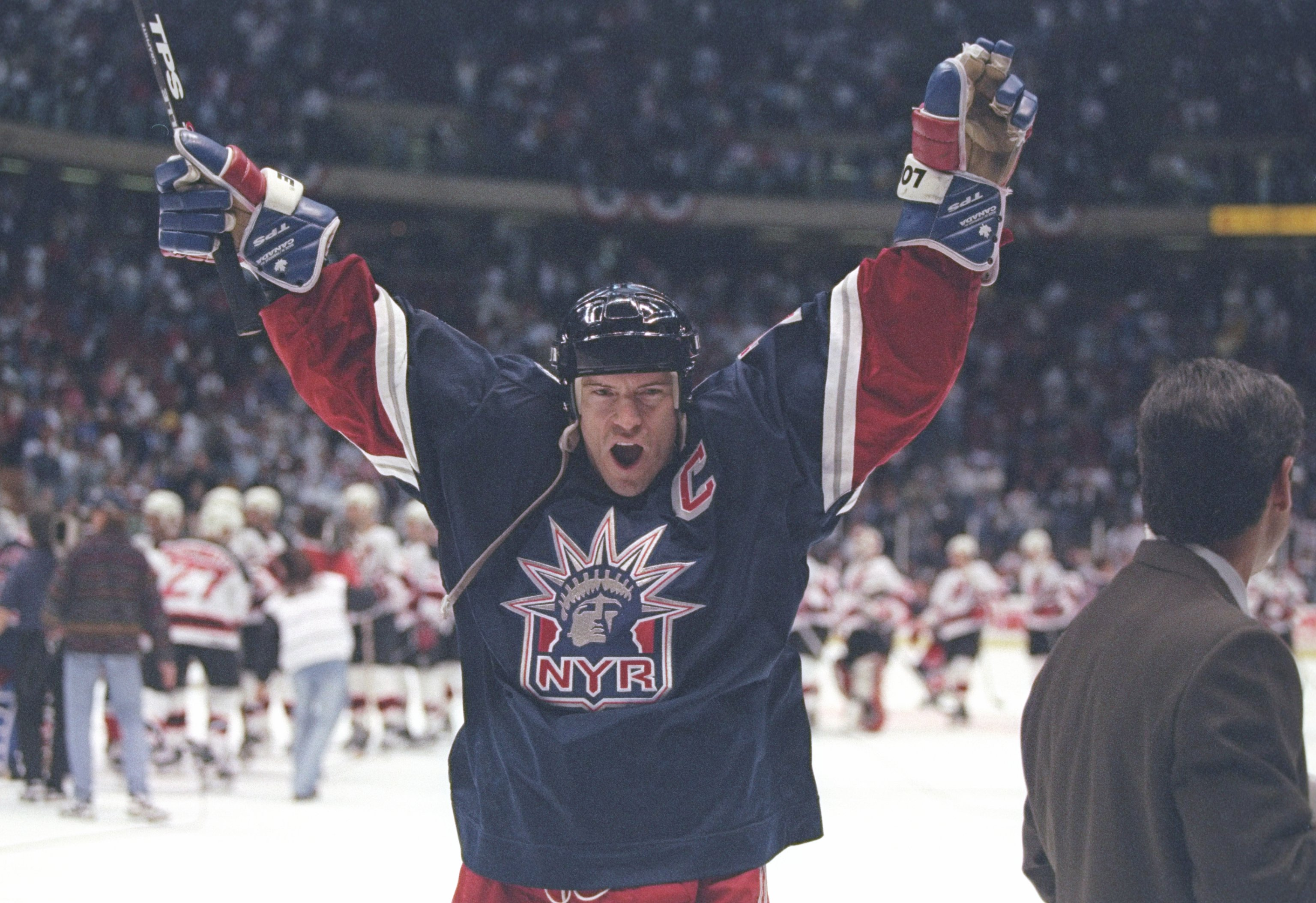 11 May 1997:  Center Mark Messier of the New York Rangers celebrates during a playoff game against the New Jersey Devils at Continental Airlines Arena in East Rutherford, New Jersey.  The Rangers won the game 2-1. Mandatory Credit: Al Bello  /Allsport