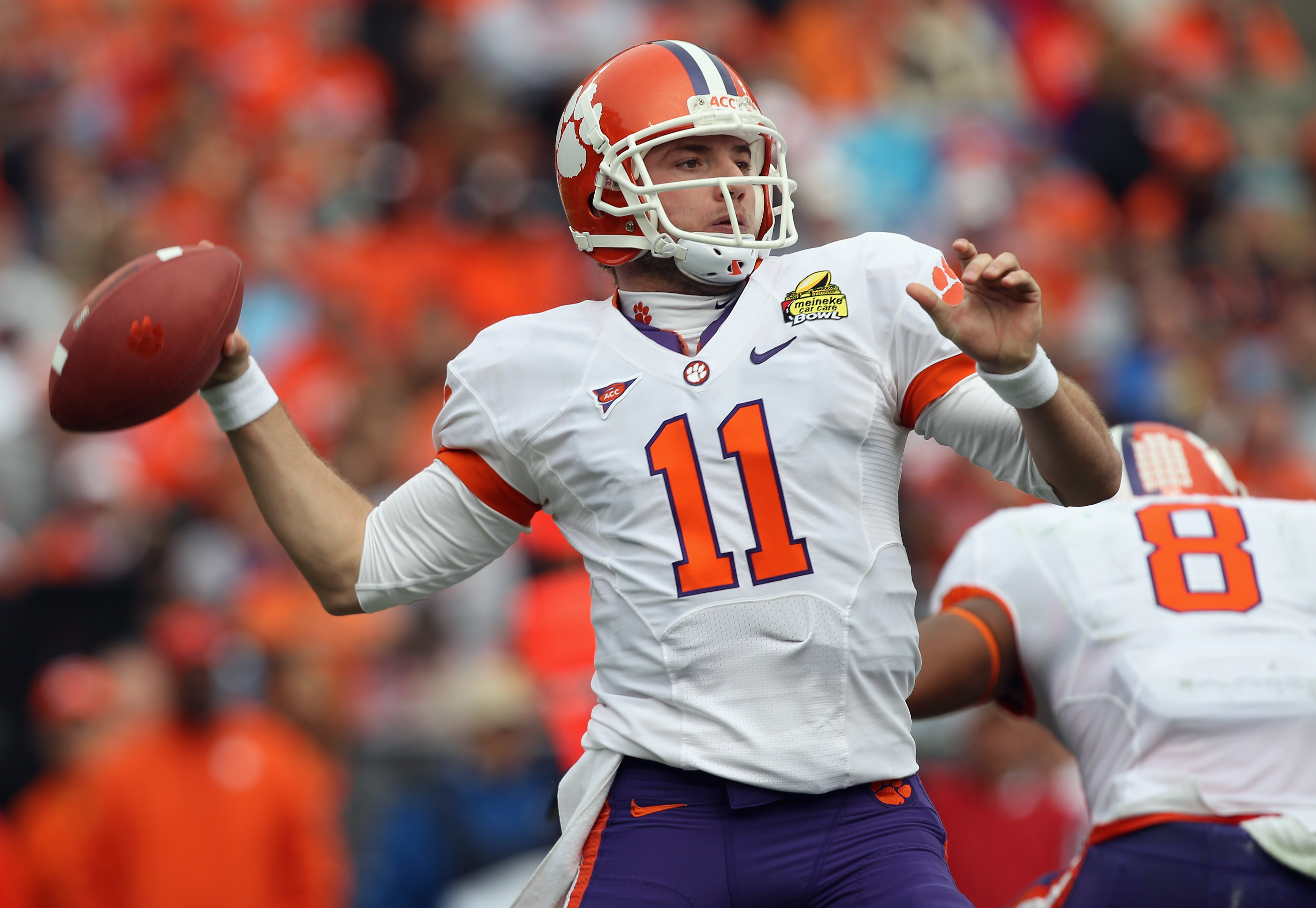CHARLOTTE, NC - DECEMBER 31:  Kyle Parker #11 of the Clemson Tigers drops back to throw a pass against the USF Bulls during their game at Bank of America Stadium on December 31, 2010 in Charlotte, North Carolina.  (Photo by Streeter Lecka/Getty Images)