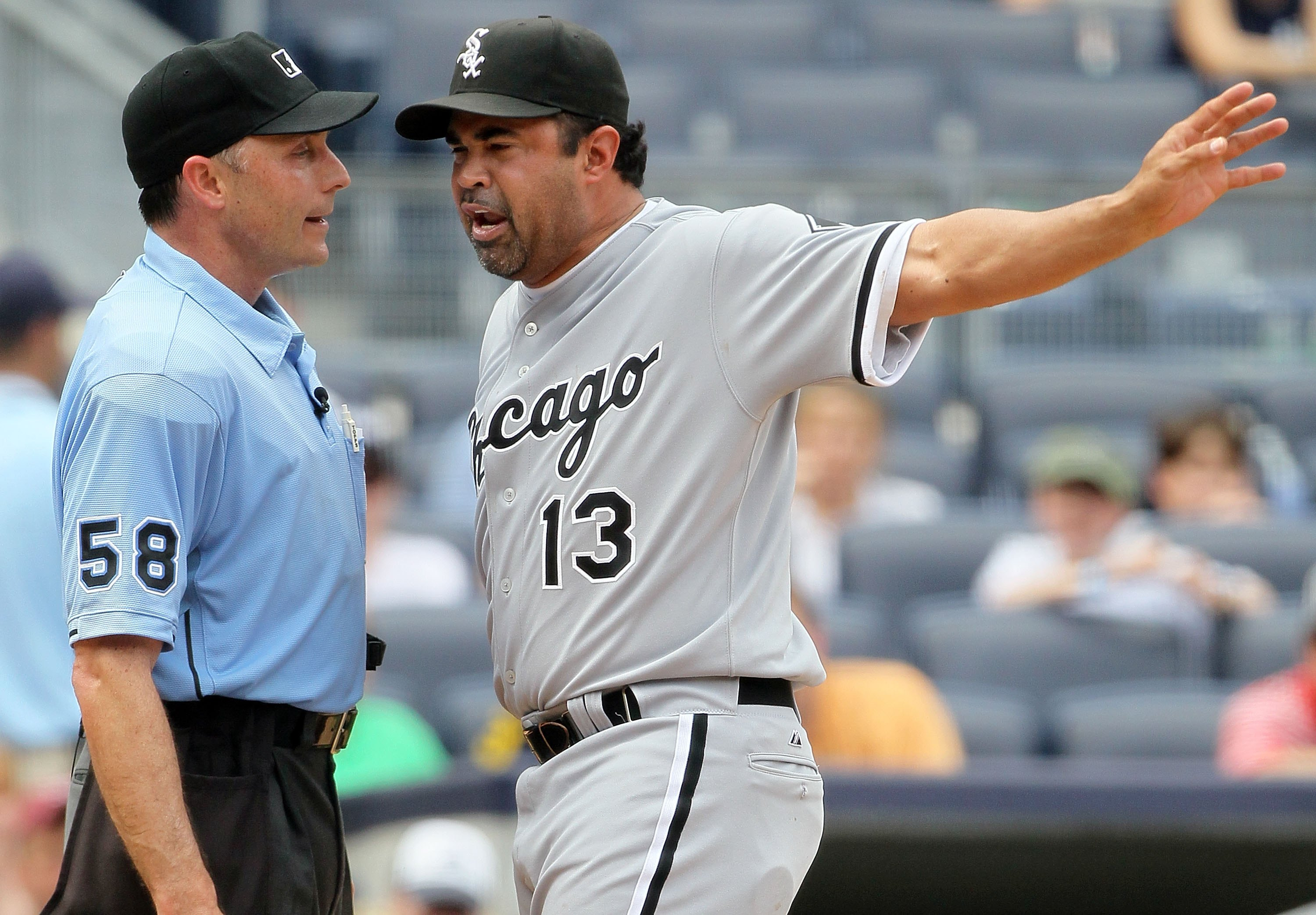 NEW YORK - MAY 02:  Manager Ozzie Guillen of the Chicago White Sox argues with home plate umpire Dan Iassogna during the game against the New York Yankees on May 2, 2010 at Yankee Stadium in the Bronx borough of New York City. The Yankees defeated the Whi