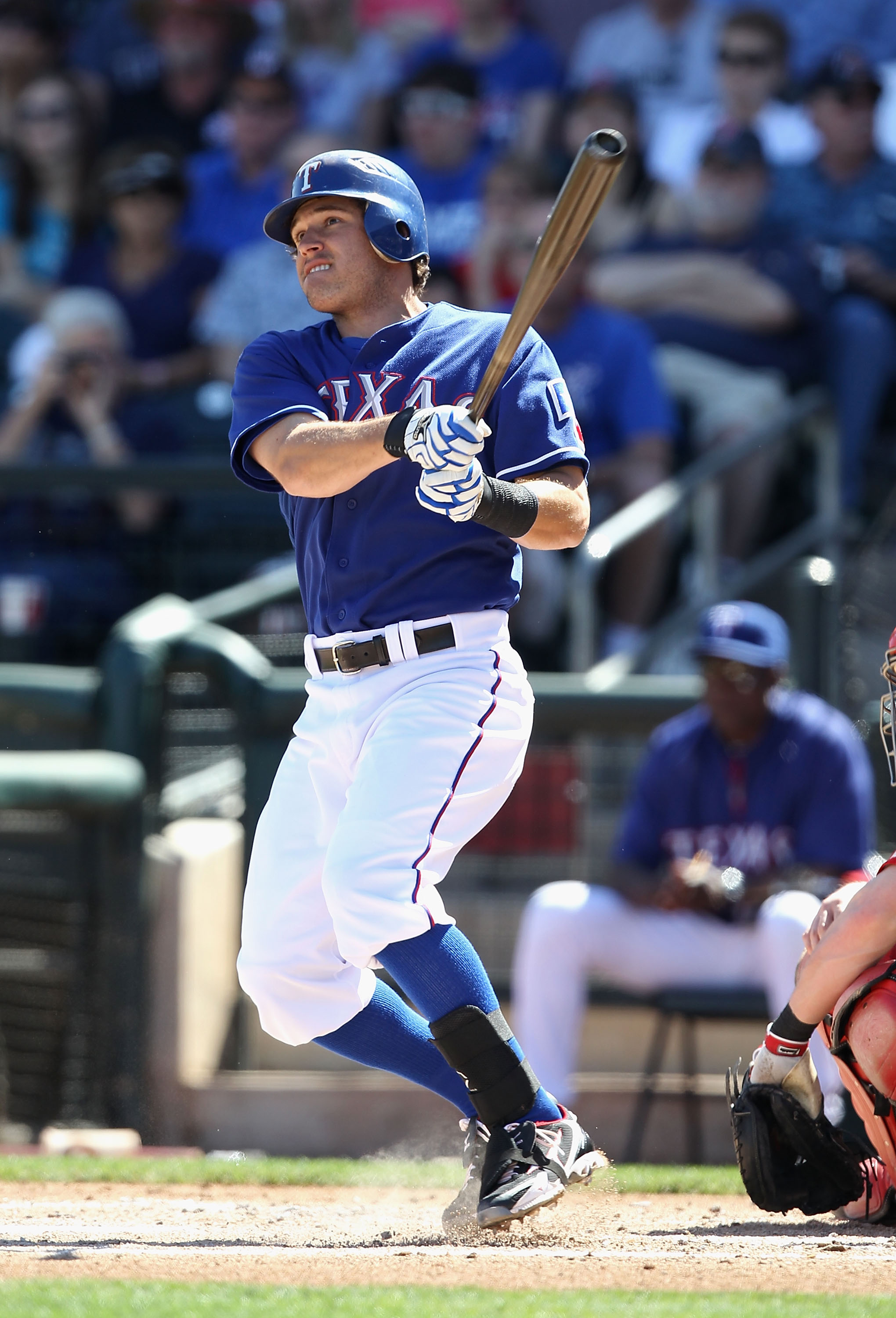 SURPRISE, AZ - MARCH 11:  Ian Kinsler #5 of the Texas Rangers hits a double against the Cincinnati Reds during the first inning of the spring training game at Surprise Stadium on March 11, 2011 in Surprise, Arizona.  (Photo by Christian Petersen/Getty Ima