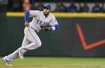 SEATTLE - MAY 04:  Shortstop Elvis Andrus #1 of the Texas Rangers tracks a ground ball against the Seattle Mariners at Safeco Field on May 4, 2011 in Seattle, Washington. (Photo by Otto Greule Jr/Getty Images)