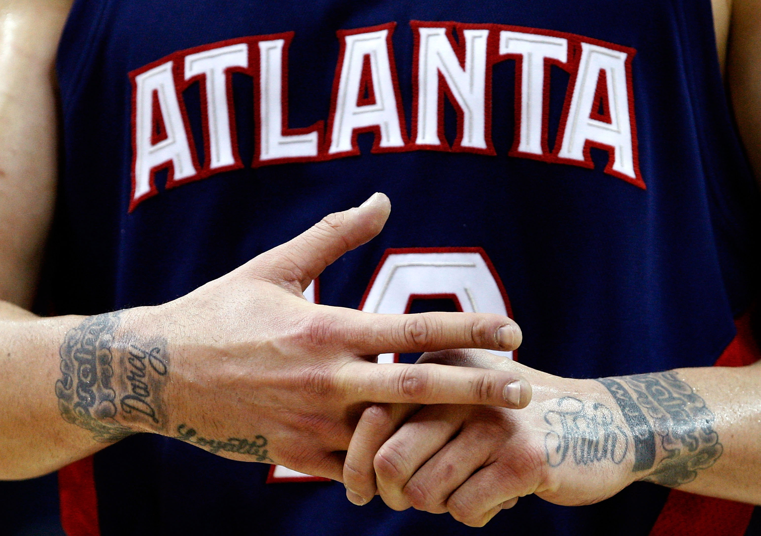 CHARLOTTE, NC - MARCH 06:  A detailed shot of the tatoos on the wrists of Mike Bibby #10 of the Atlanta Hawks against the Charlotte Bobcats during their game at Time Warner Cable Arena on March 6, 2009 in Charlotte, North Carolina. NOTE TO USER: User expr