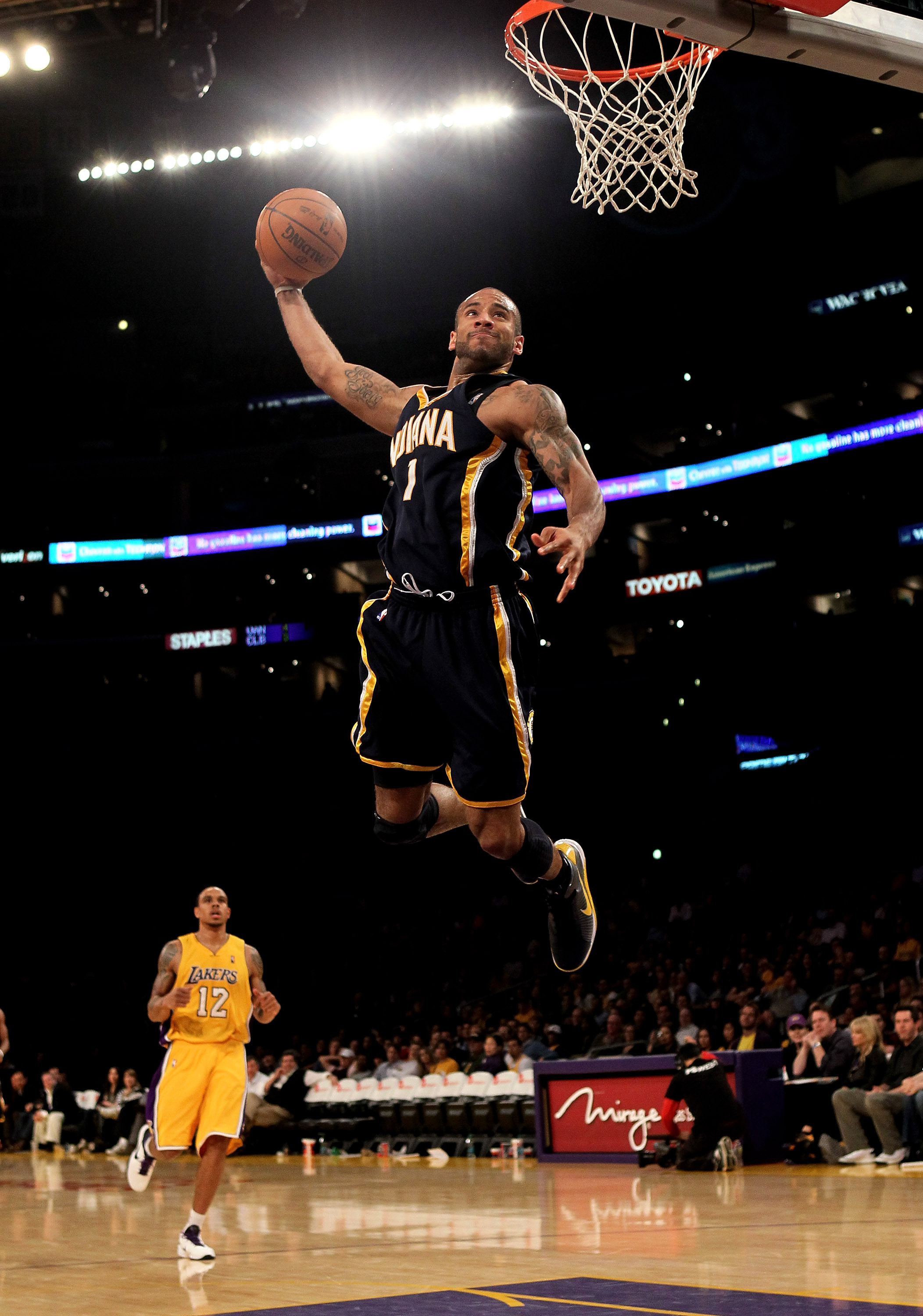 LOS ANGELES, CA - MARCH 02:  Dahntay Jones #1 of the Indiana Pacers goes up for a breakaway dunk against the Los Angeles Lakers on March 2, 2010 at Staples Center in Los Angeles, California. The Lakers won 122-99.  NOTE TO USER: User expressly acknowledge