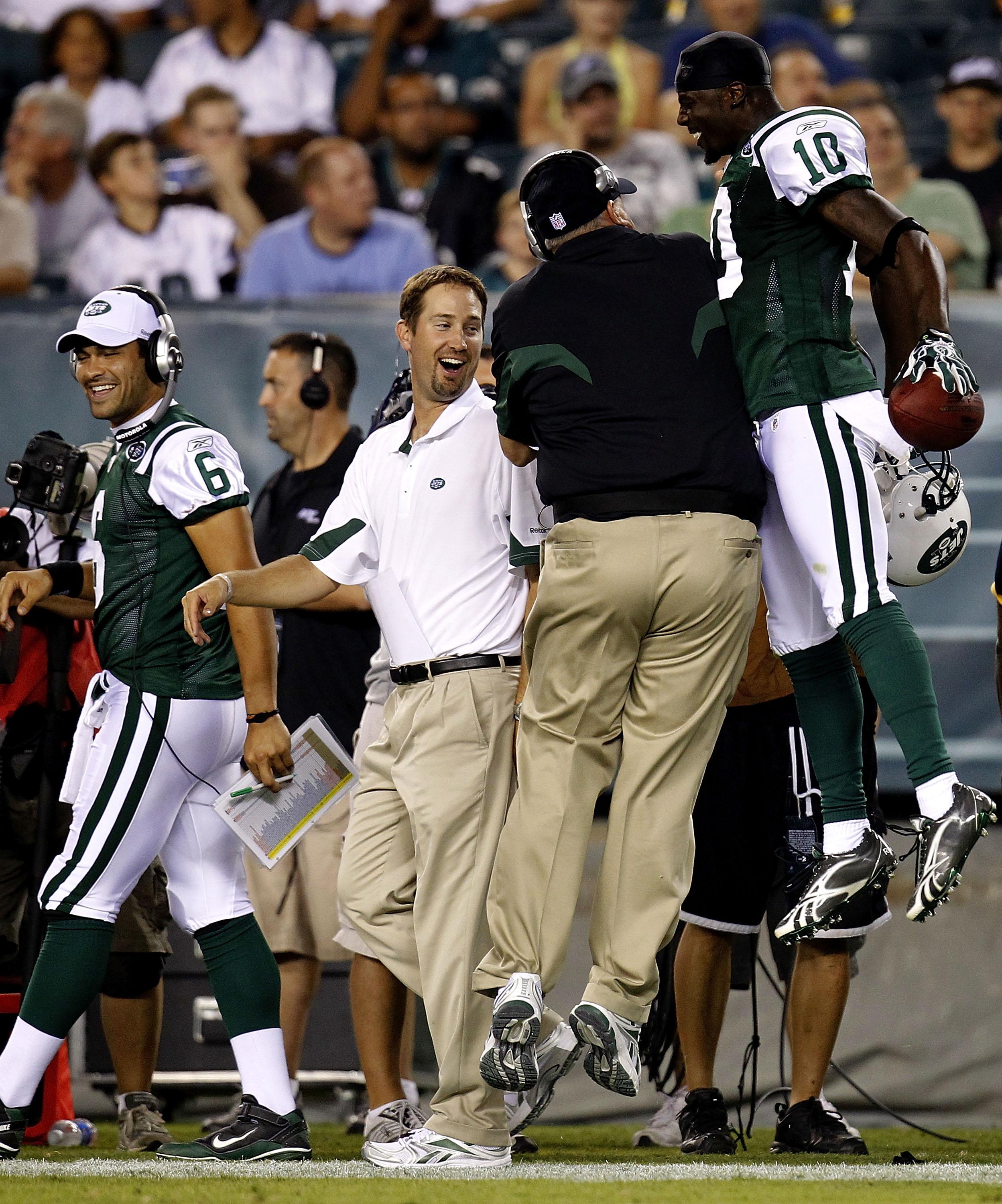PHILADELPHIA - SEPTEMBER 02: Santonio Holmes #10 and head coach Rex Ryan (back to camera) of the New York Jets celebrate a touchdown as Mark Sanchez #6 and offensive coordinator Brian Schottenheimer of the Jets look on in a preseason game against the Phil