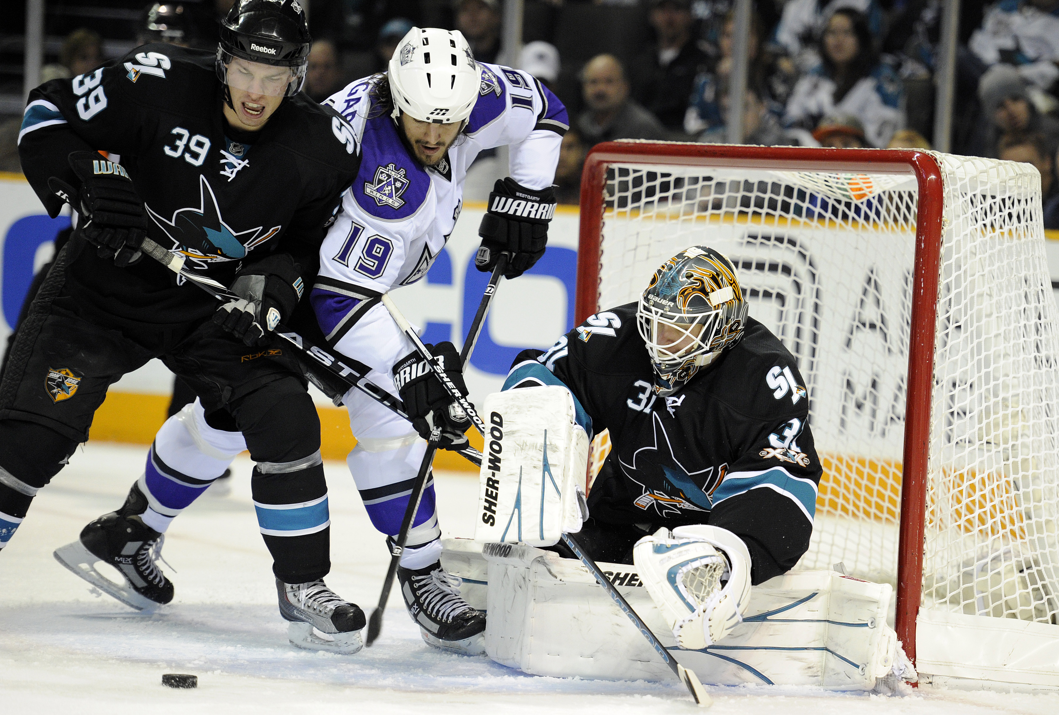 SAN JOSE, CA - DECEMBER 27:  Goalie Antti Niemi #31of the San Jose Sharks makes a save on the rebound shot of Kevin Westgarth #19 of the Los Angeles Kings during an NHL hockey game at the HP Pavilion on December 27, 2010 in San Jose, California. (Photo by