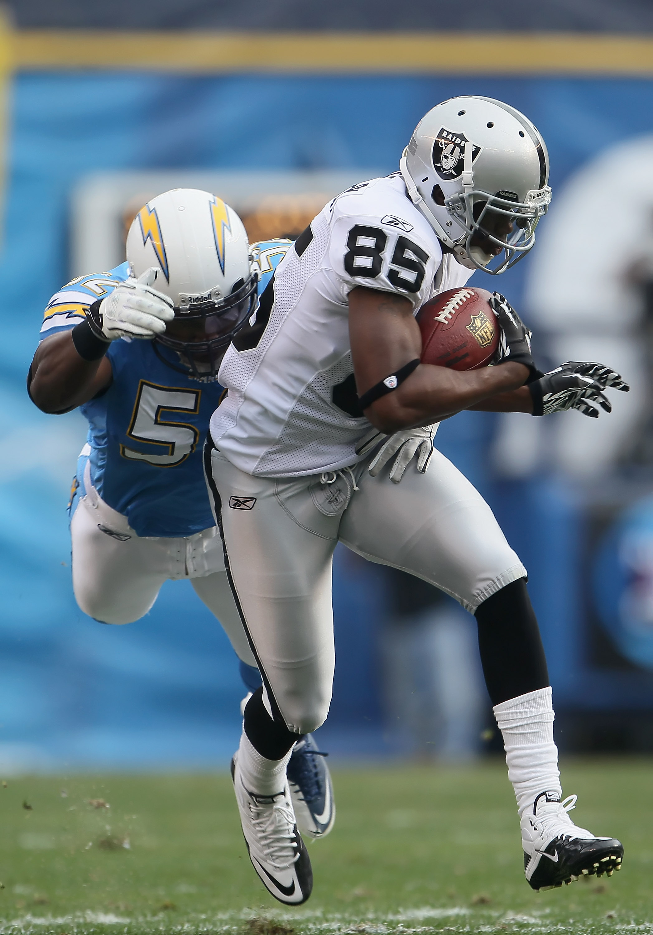 SAN DIEGO - DECEMBER 05:  Darrius Heyward-Bey #85 of the Oakland Raiders is tackled by Larry English #52 of the San Diego Chargers in the second quarter at Qualcomm Stadium on December 5, 2010 in San Diego, California. The Raiders defeated the Chargers 28