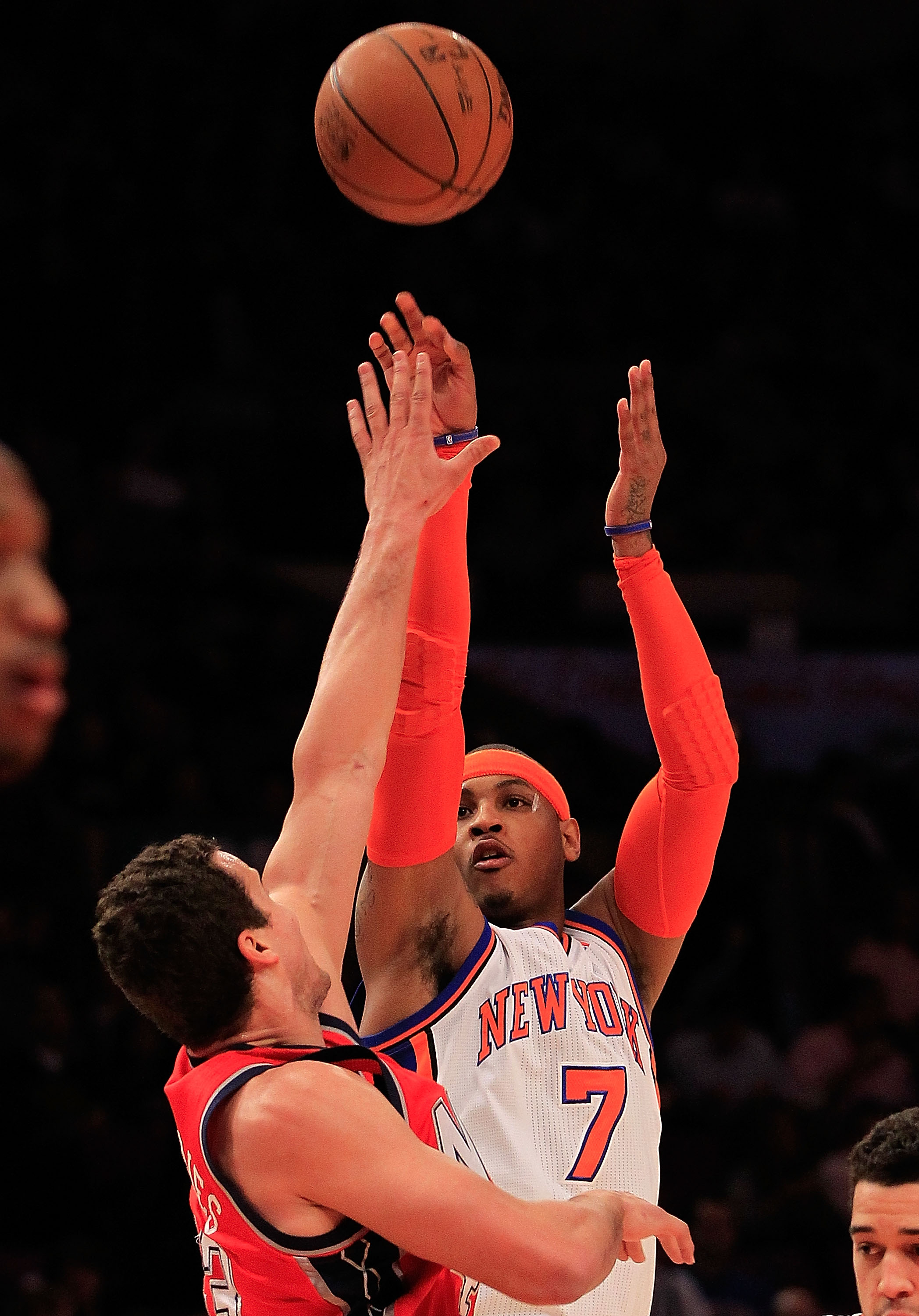 NEW YORK, NY - MARCH 30:  Carmelo Anthony #7 of the New York Knicks shoots over Kris Humphries #43 of the New Jersey Nets at Madison Square Garden on March 30, 2011 in New York City. NOTE TO USER: User expressly acknowledges and agrees that, by downloadin