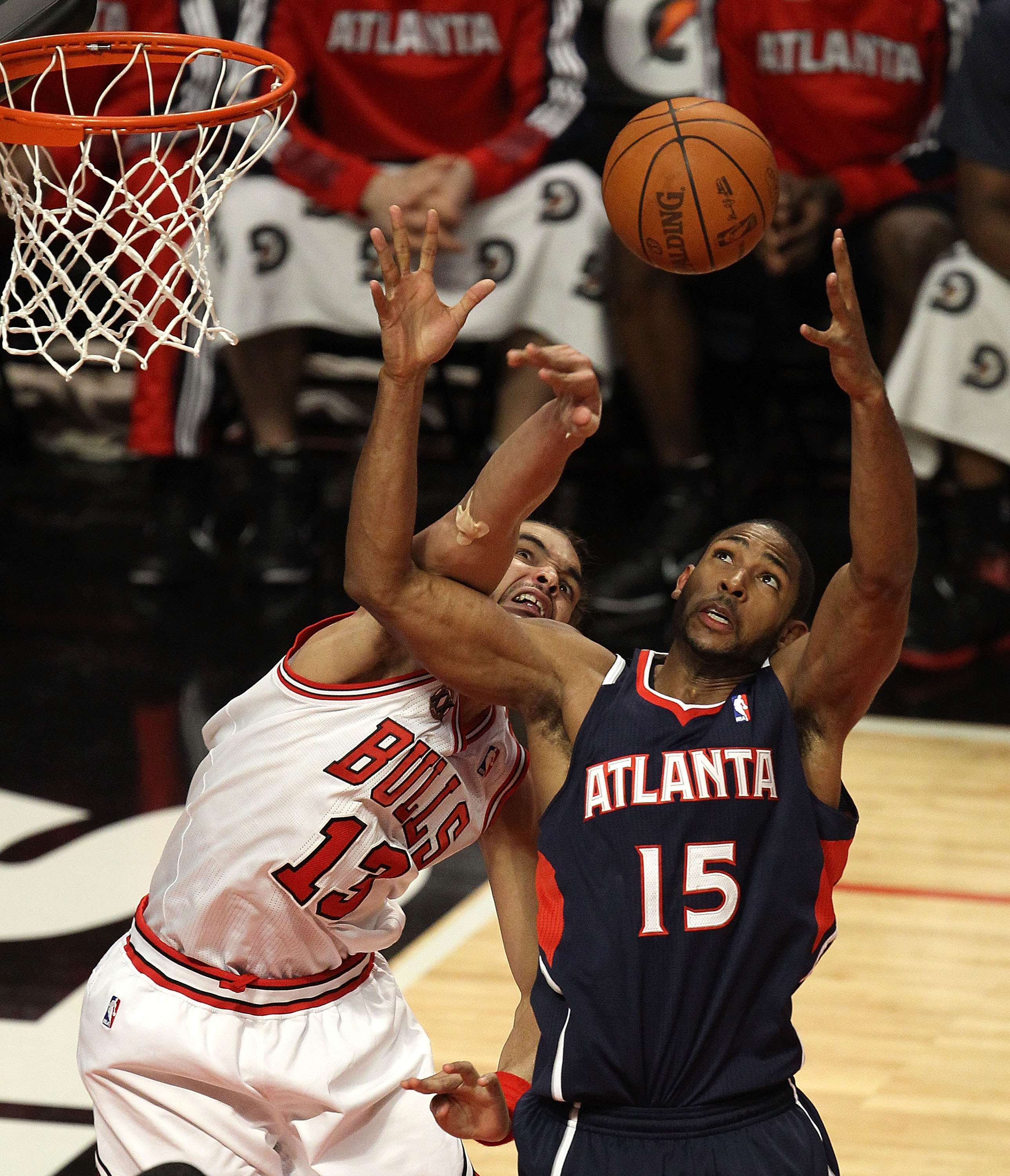 CHICAGO, IL - MARCH 11: Joakim Noah #13 of the Chicago Bulls knocks the ball away from Al Horford #15 of the Atlanta Hawks at the United Center on March 11, 2011 in Chicago, Illinois. The Bulls defeated the Hawks 94-76. NOTE TO USER: User expressly acknow