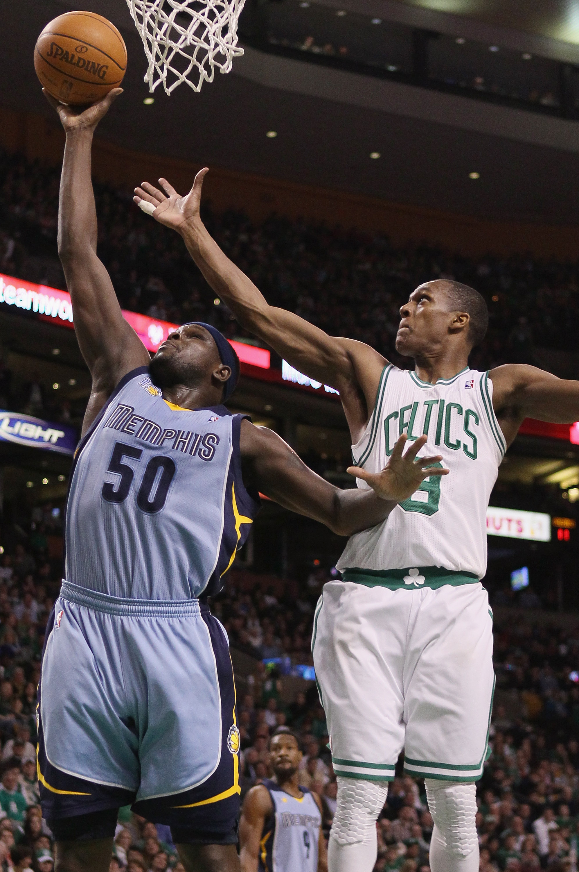 BOSTON, MA - MARCH 23:  Zach Randolph #50 of the Memphis Grizzlies takes a shot as Rajon Rondo #9 of the Boston Celtics defends on March 23, 2011 at the TD Garden in Boston, Massachusetts.  NOTE TO USER: User expressly acknowledges and agrees that, by dow