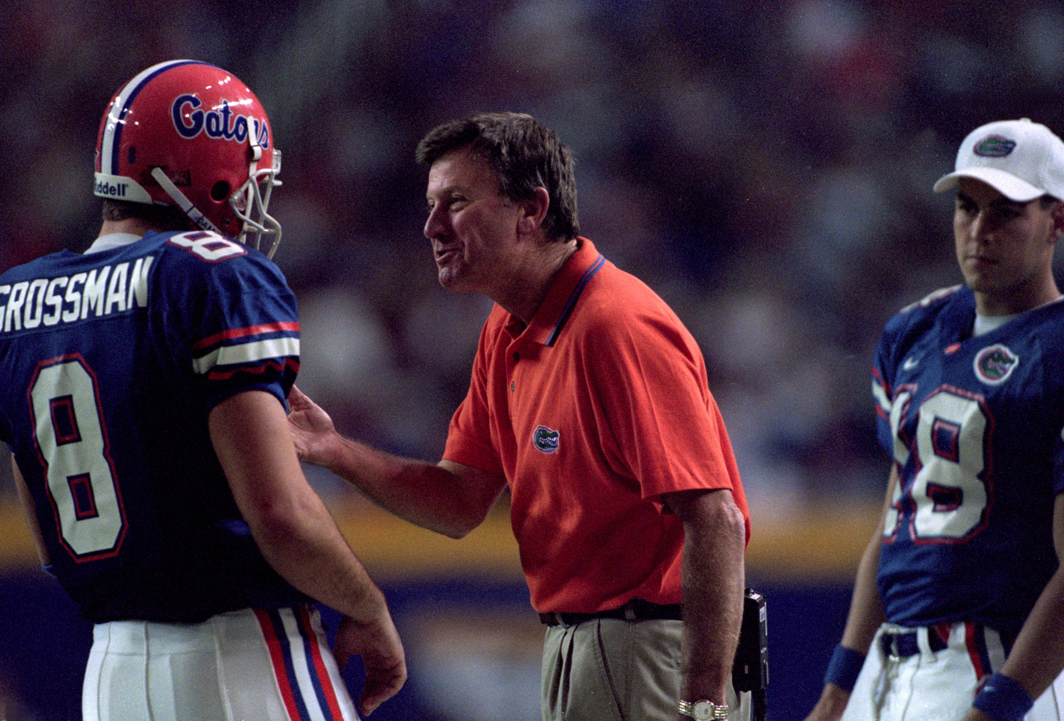 A former quarterback, Steve Spurrier now gives instructions to passers, like here with former Gator Rex Grossman.