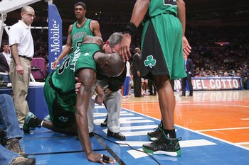 NEW YORK - FEBRUARY 06:  Kevin Garnett #5 of the Boston Celtics is injured against the New York Knicks at Madison Square Garden on February 6, 2009 in New York City. NOTE TO USER: User expressly acknowledges and agrees that, by downloading and/or using th
