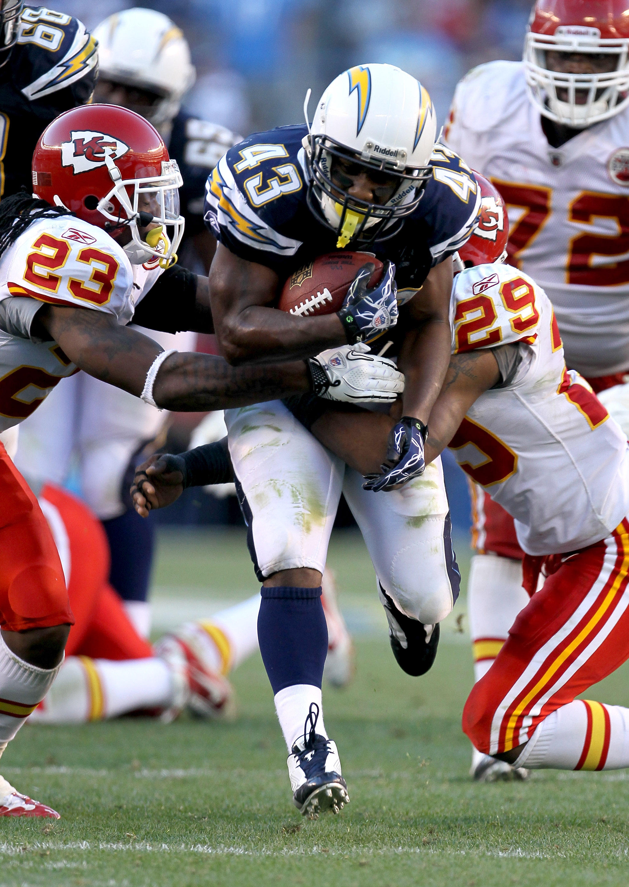 SAN DIEGO - DECEMBER 12: Running back Darren Sproles #43 of the San Diego Chargers carries the ball against safeties Eric Berry #29 and Kendrick Lewis #23 of the Kansas City Chiefs at Qualcomm Stadium on December 12, 2010 in San Diego, California.  the Ch