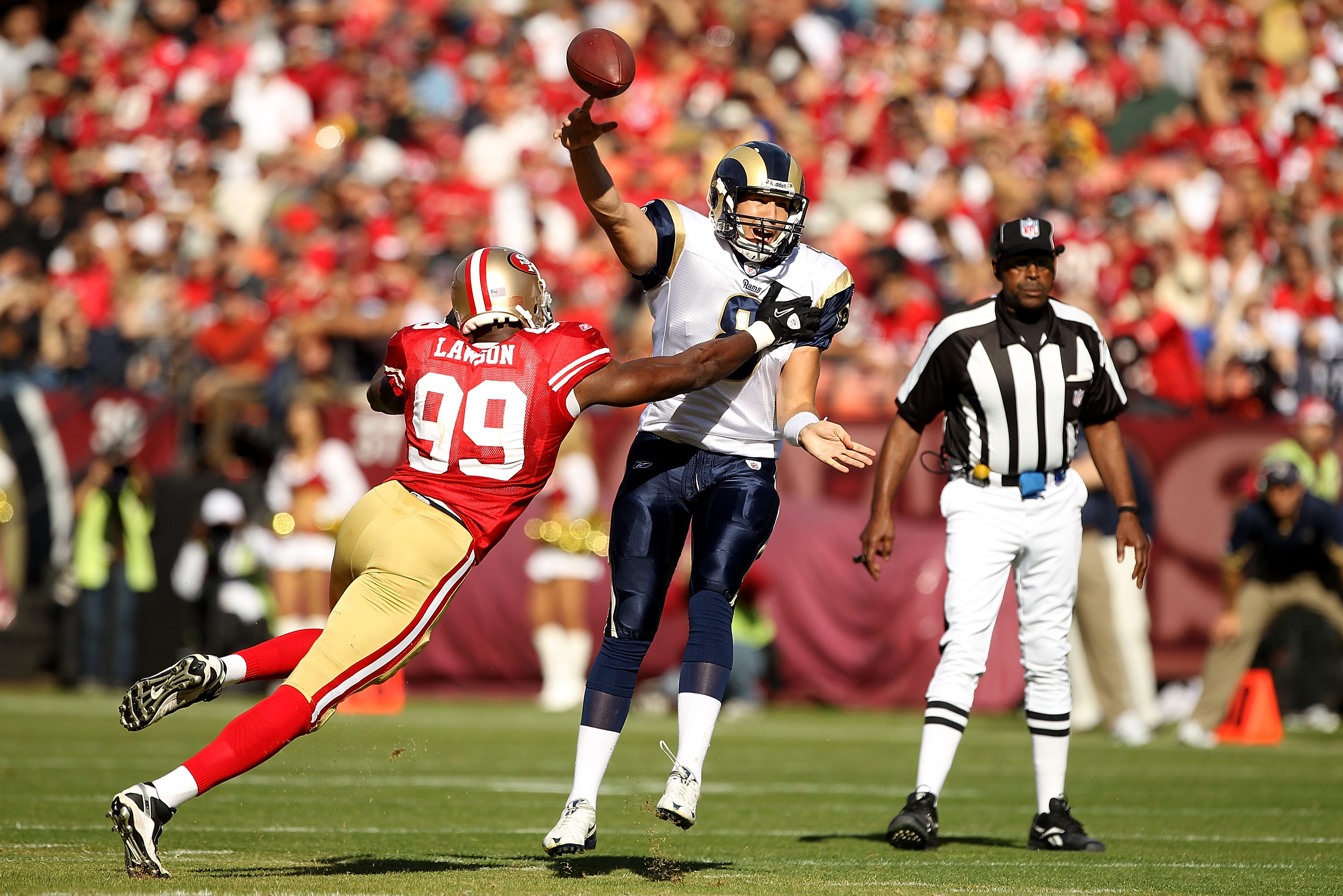 SAN FRANCISCO - NOVEMBER 14:  Sam Bradford #8 of the St. Louis Rams throws the ball as he is hit by Manny Lawson #99 of the San Francisco 49ers at Candlestick Park on November 14, 2010 in San Francisco, California.  (Photo by Ezra Shaw/Getty Images)