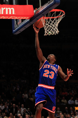 NEW YORK, NY - FEBRUARY 23: Toney Douglas #23 of the New York Knicks goes up for a basket against  the Milwaukee Bucks at Madison Square Garden on February 23, 2011 in New York City. NOTE TO USER: User expressly acknowledges and agrees that, by downloadin