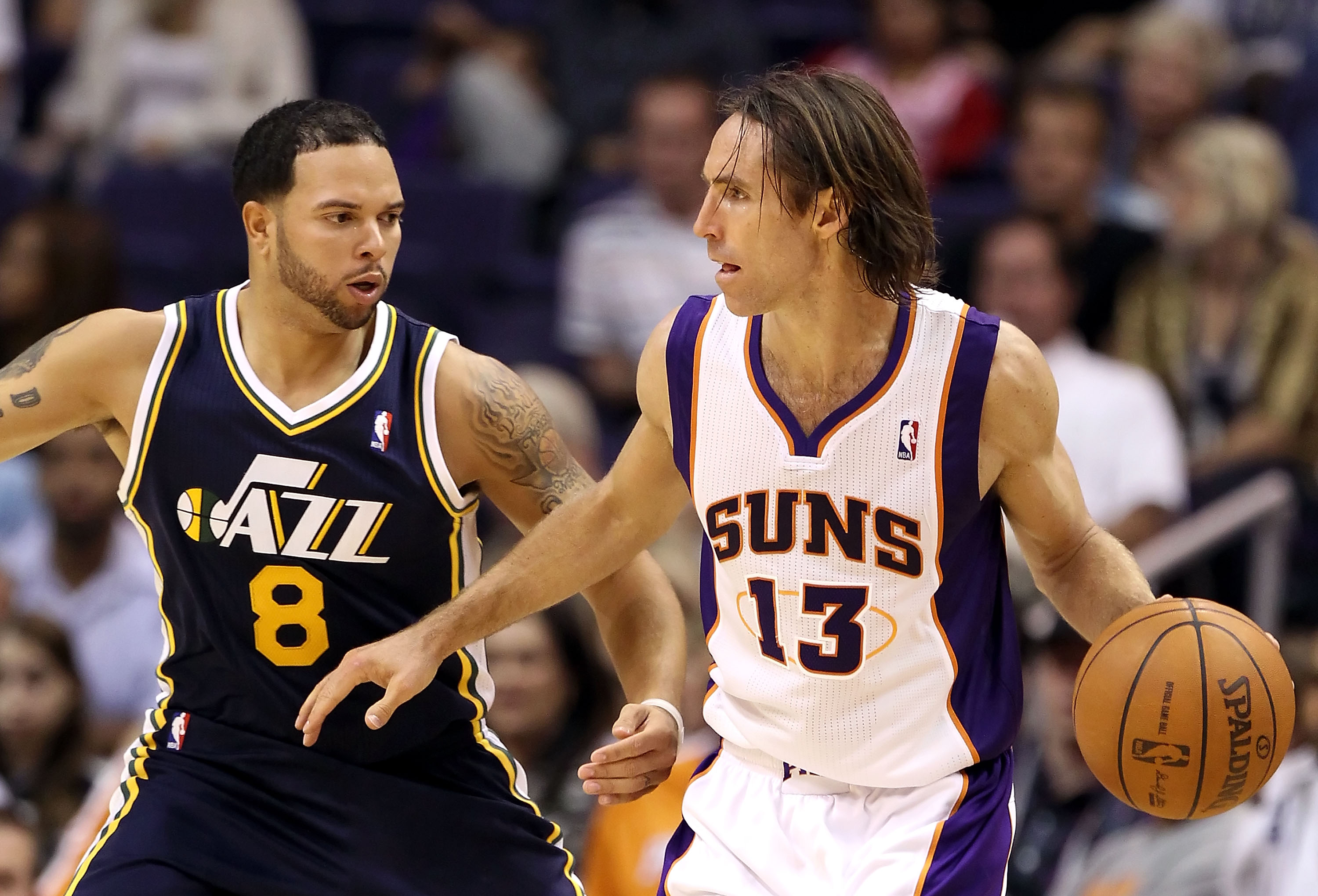 PHOENIX - OCTOBER 12:  Steve Nash #13 of the Phoenix Suns looks to pass the ball during the preseason NBA game against the Utah Jazz at US Airways Center on October 12, 2010 in Phoenix, Arizona. NOTE TO USER: User expressly acknowledges and agrees that, b