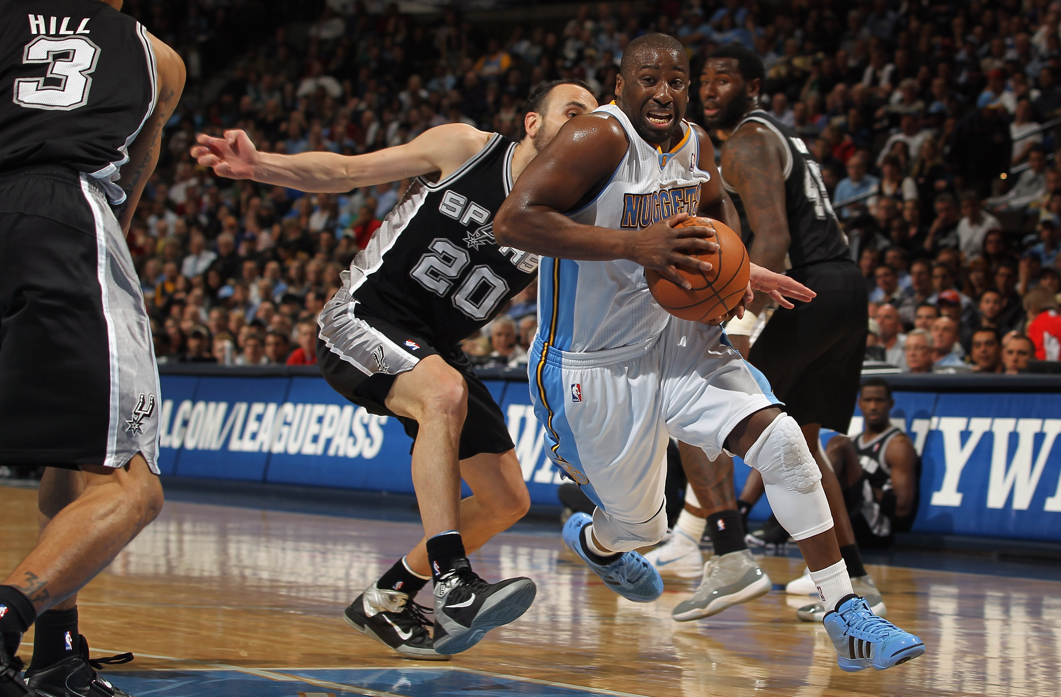 DENVER, CO - MARCH 23:  Raymond Felton #20 of the Denver Nuggets drives past Manu Ginobili #20 of the San Antonio Spurs at the Pepsi Center on March 23, 2011 in Denver, Colorado. The Nuggets defeated the Spurs 115-112. NOTE TO USER: User expressly acknowl