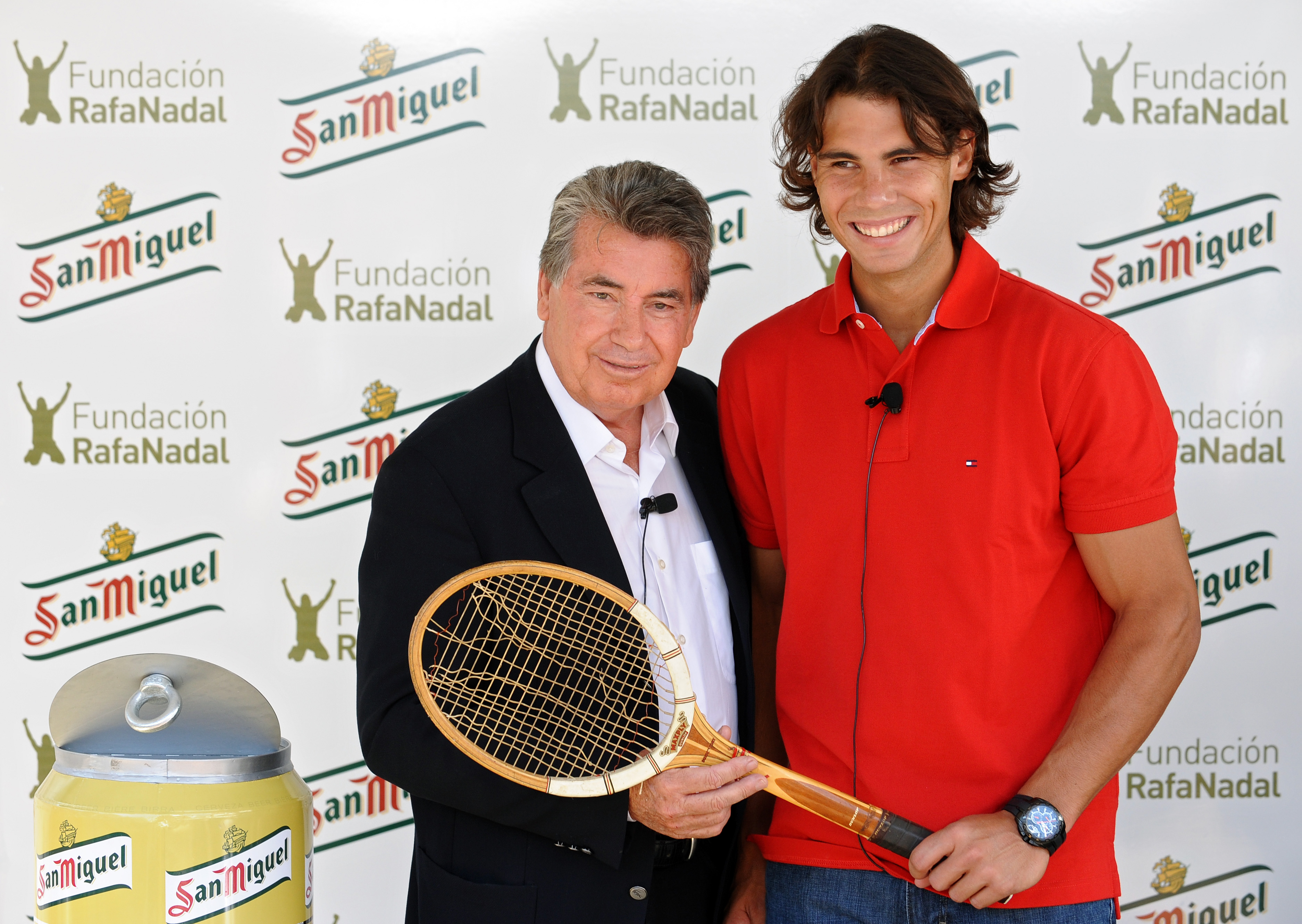 BARCELONA, SPAIN - APRIL 21:  Former tennis great Manolo Santana (L) and Rafael Nadal hold a racket used by Santana in the year he won the Wimbledon Championships during a promotional event for Nadal's foundation on day two of the ATP 500 World Tour Barce
