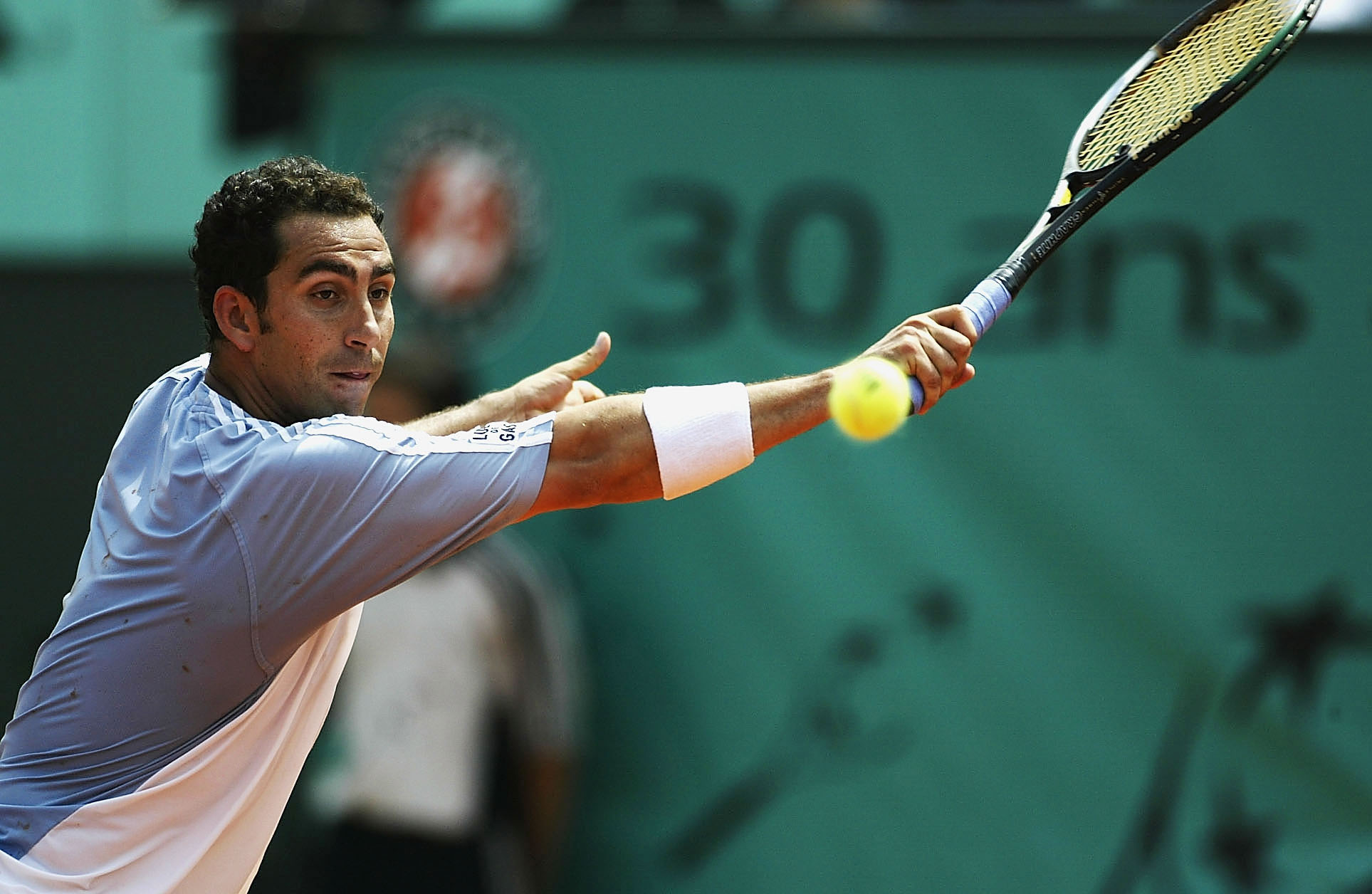 PARIS, FRANCE - JUNE 4:  Albert Costa of Spain returns in his quarter final match against Tommy Robredo of Spain during the tenth day of the French Open on June 4, 2003 at Roland Garros in Paris, France. (Photo by Clive Mason/Getty Images)