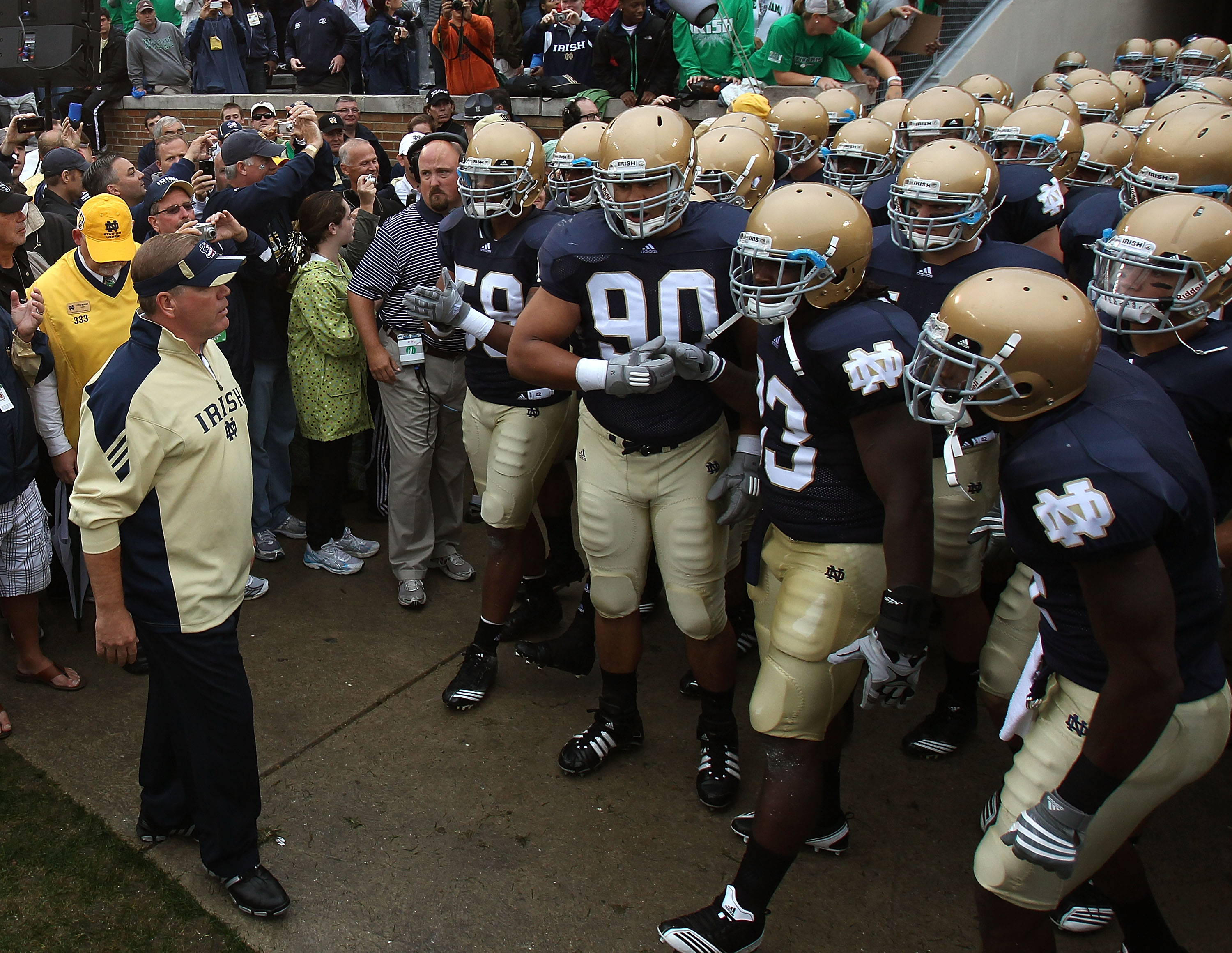 SOUTH BEND, IN - SEPTEMBER 11: Head coach Brian Kelly of the Notre Dame Fighting Irish (L) waits to enter the field with his team before a game against the Michigan Wolverines at Notre Dame Stadium on September 11, 2010 in South Bend, Indiana. Michigan de