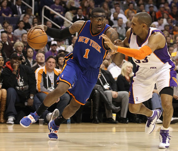 PHOENIX, AZ - JANUARY 07:  Amar'e Stoudemire #1 of the New York Knicks drives the ball against Grant Hill #33 of the Phoenix Suns during the NBA game at US Airways Center on January 7, 2011 in Phoenix, Arizona.  NOTE TO USER: User expressly acknowledges a