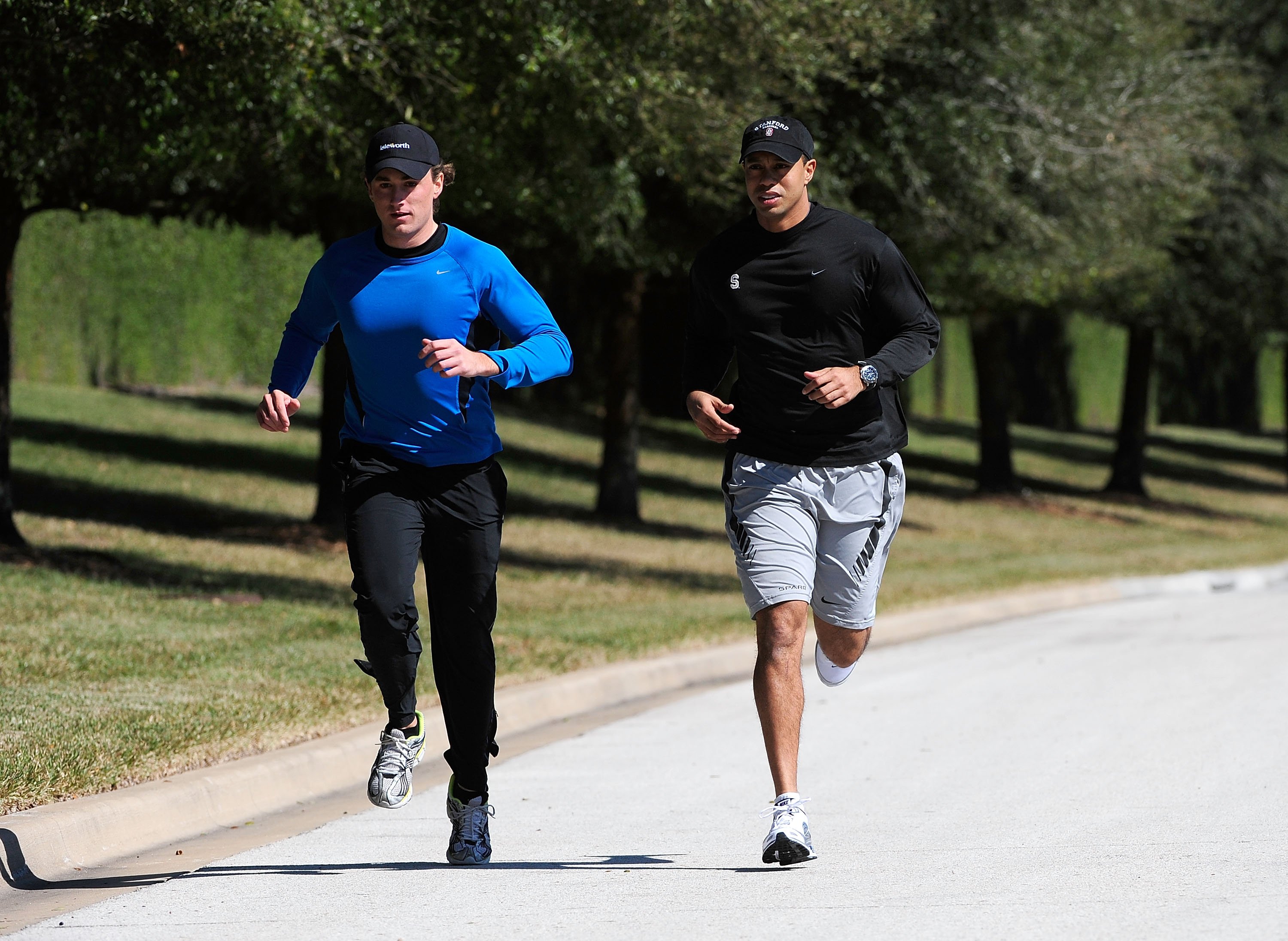 ORLANDO, FL - FEBRUARY 17:  Tiger Woods (R) jogs with an unidentified friend near his home on February 17, 2010 in Orlando, Florida. The PGA Tour has just announced that Tiger Woods will make a statement this Friday morning (February 19, 2010) at their he