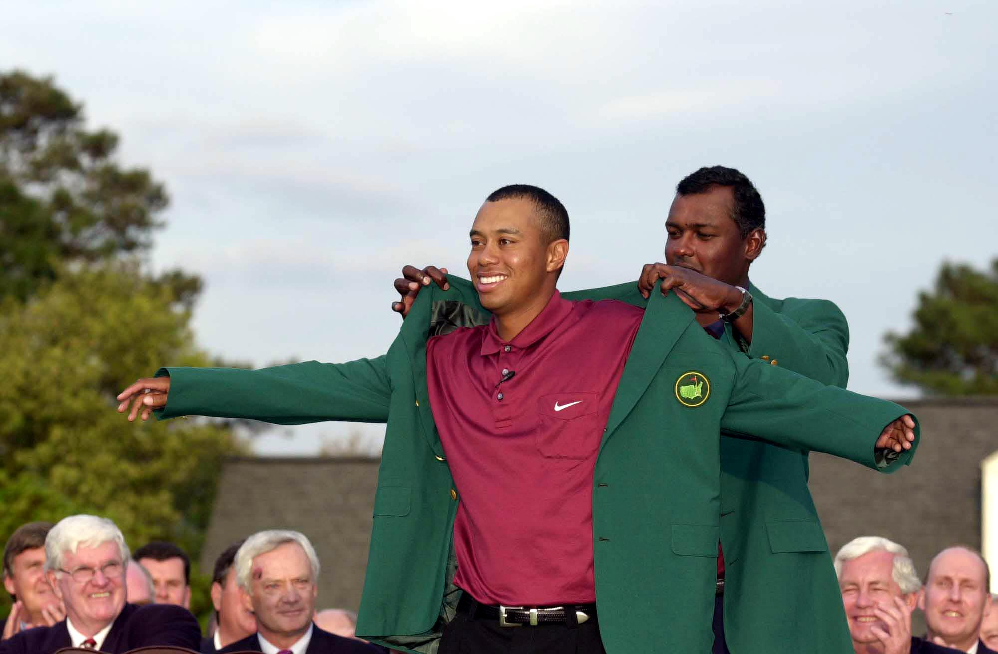 8 Apr 2001:  Tiger Woods of the USA is presented with his second green jacket by defending champion Vijay Singh of Fiji after the final day of the 2001 Masters at the Augusta National Golf Club, Augusta, Georgia, USA. DIGITAL IMAGE Mandatory Credit: Harry