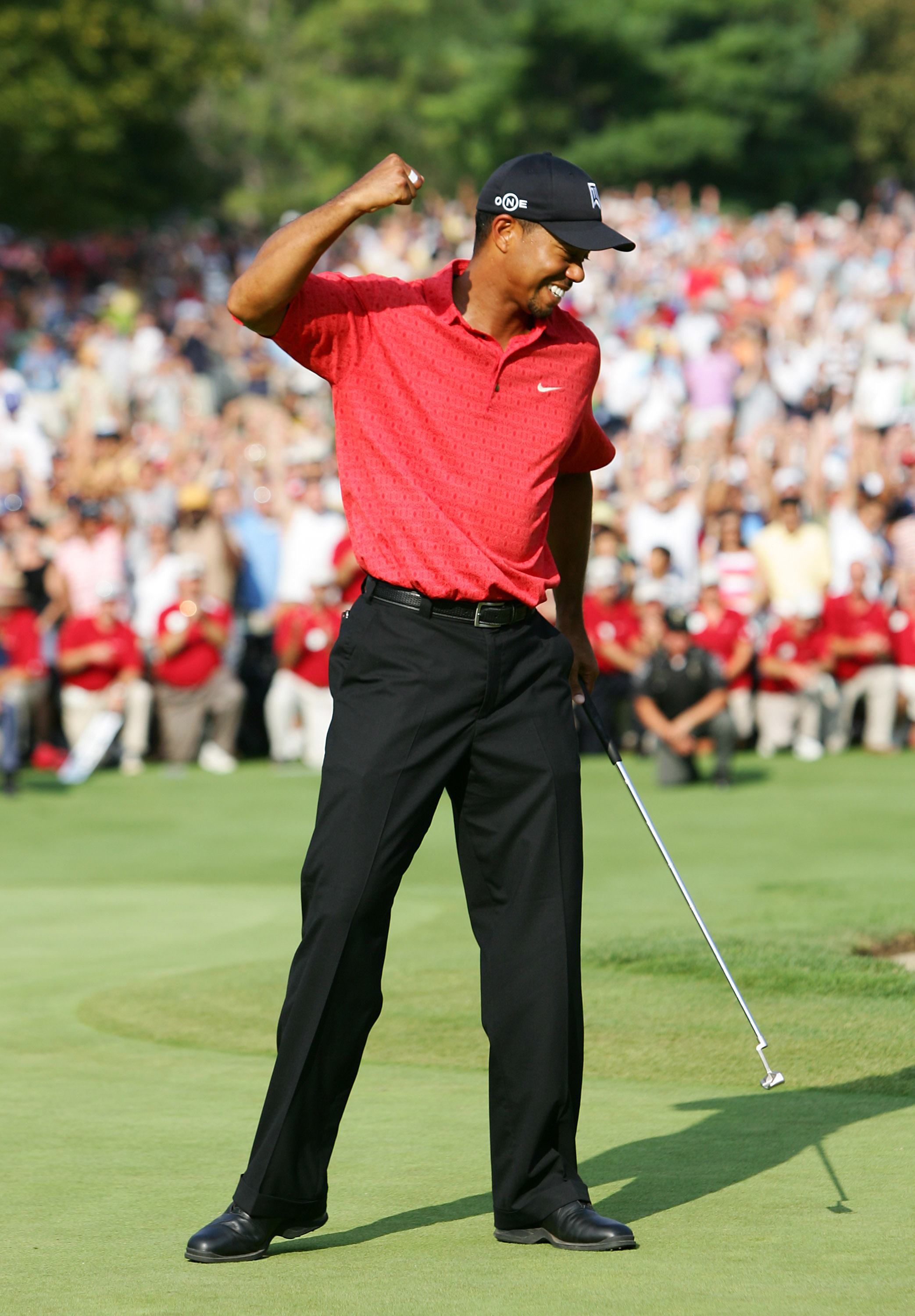 UNITED STATES - AUGUST 06:  Tiger Woods reacts to winning the Buick Open at Warwick Hills Golf and Country Club in Grand Blanc, Michigan on August 6, 2006.  (Photo by Sam Greenwood/Getty Images)