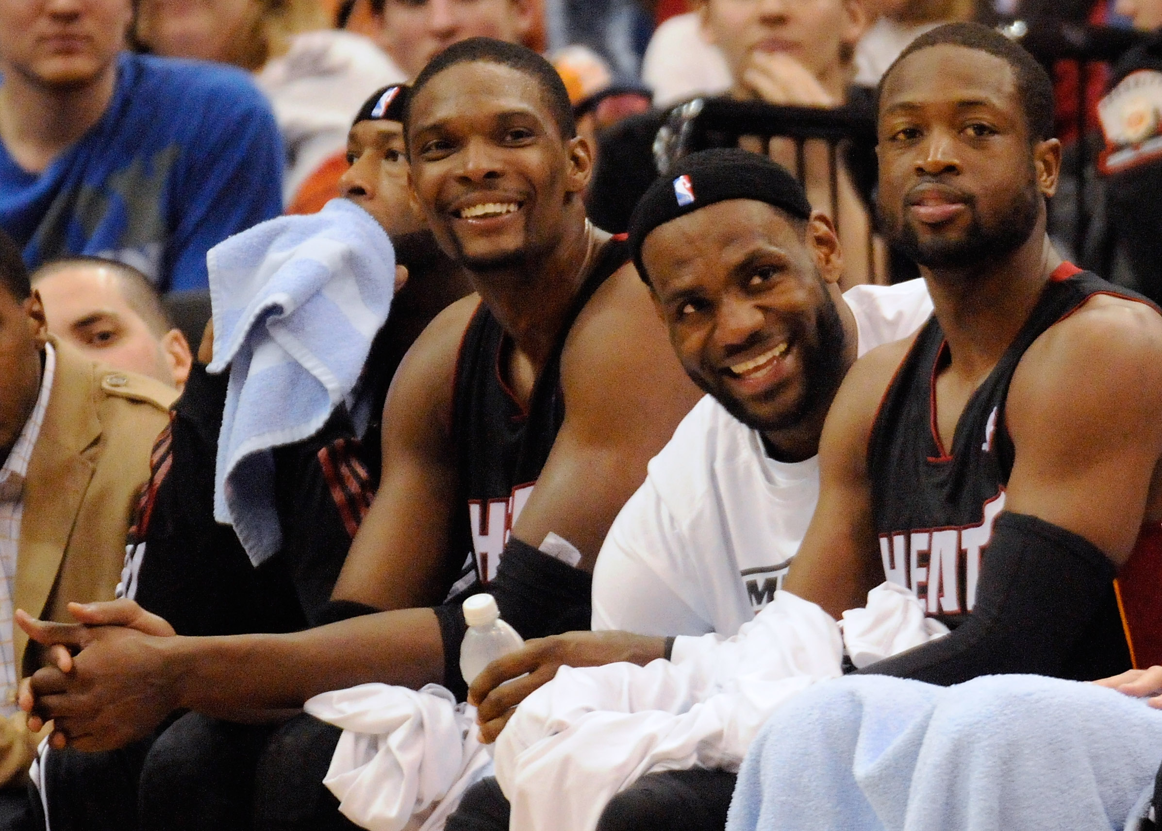 MINNEAPOLIS, MN - APRIL 1: Chris Bosh #1, LeBron James #6 and Dwyane Wade #3 of the Miami Heat sit on the bench in the final minutes of a basketball game against the Minnesota Timberwolves at Target Center on April 1, 2011 in Minneapolis, Minnesota. Heat