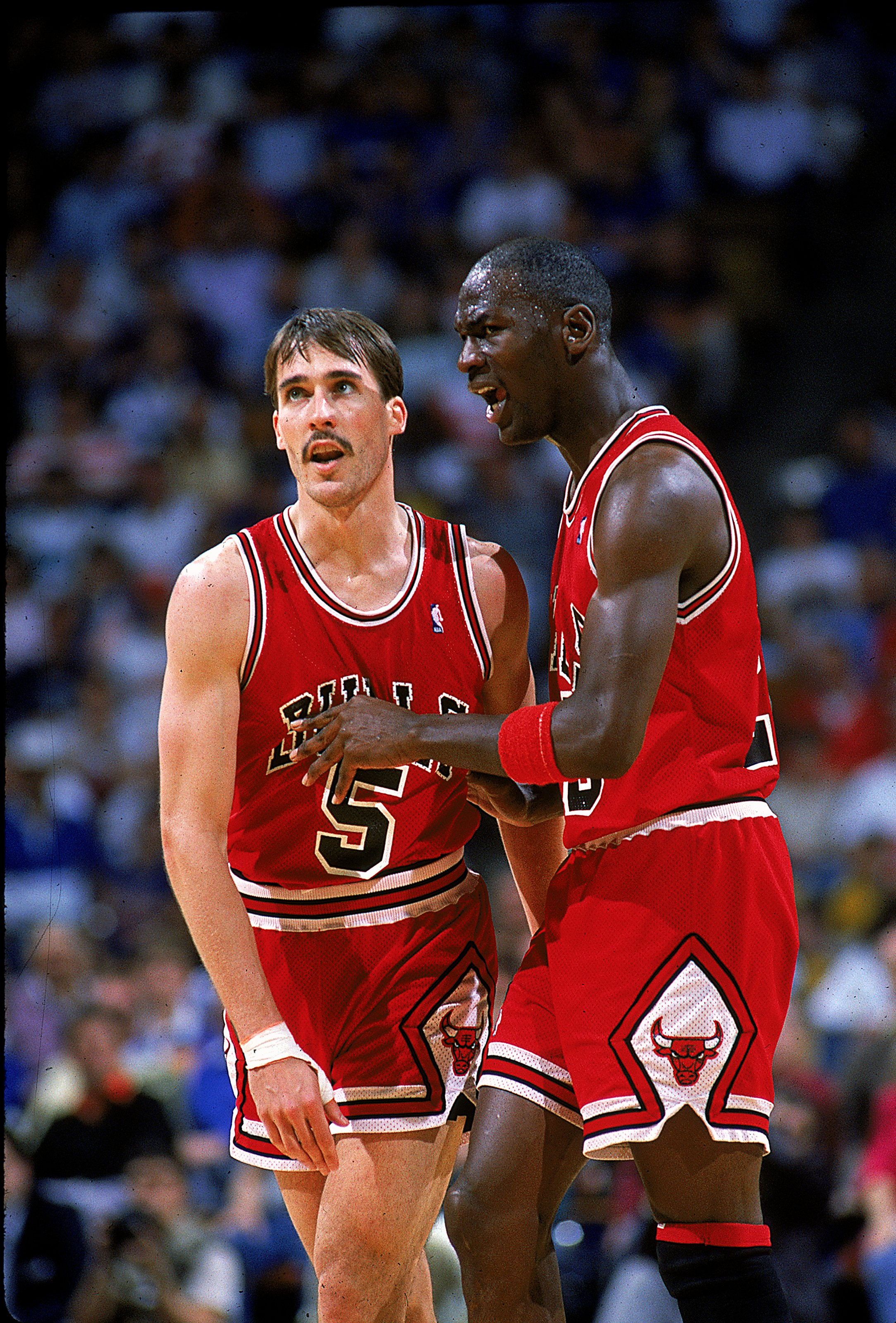 1987-1988:  Michael Jordan #23 of the Chicago Bulls walks with teammate on the court during the game.   Mandatory Credit: Allsport  /Allsport