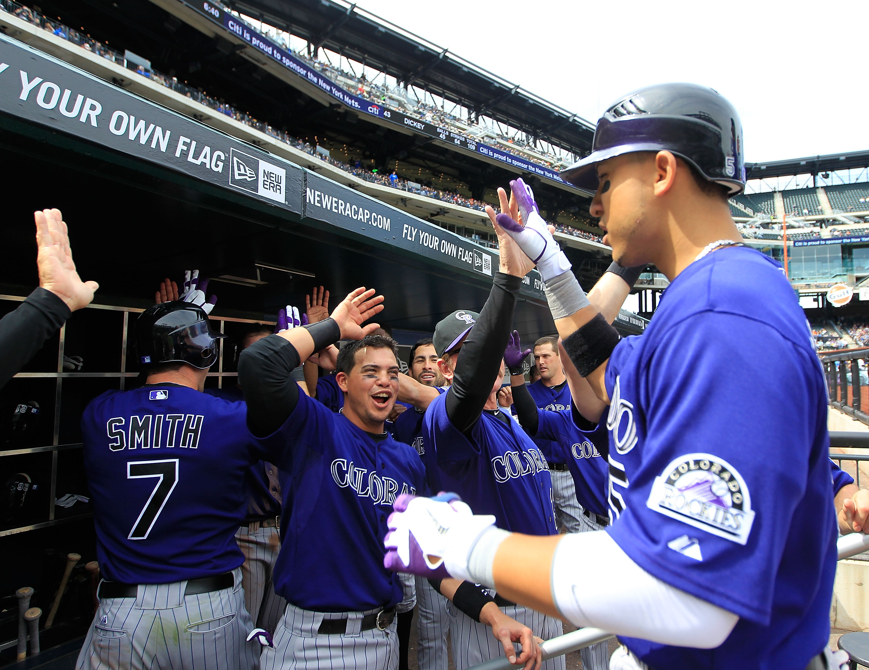 NEW YORK, NY - APRIL 14:  Carlos Gonzalez #5 of the Colorado Rockies is congratulated by his teammates on his seventh-inning home run against the New York Mets at Citi Field on April 14, 2011 in the Flushing neighborhood of the Queens borough of New York