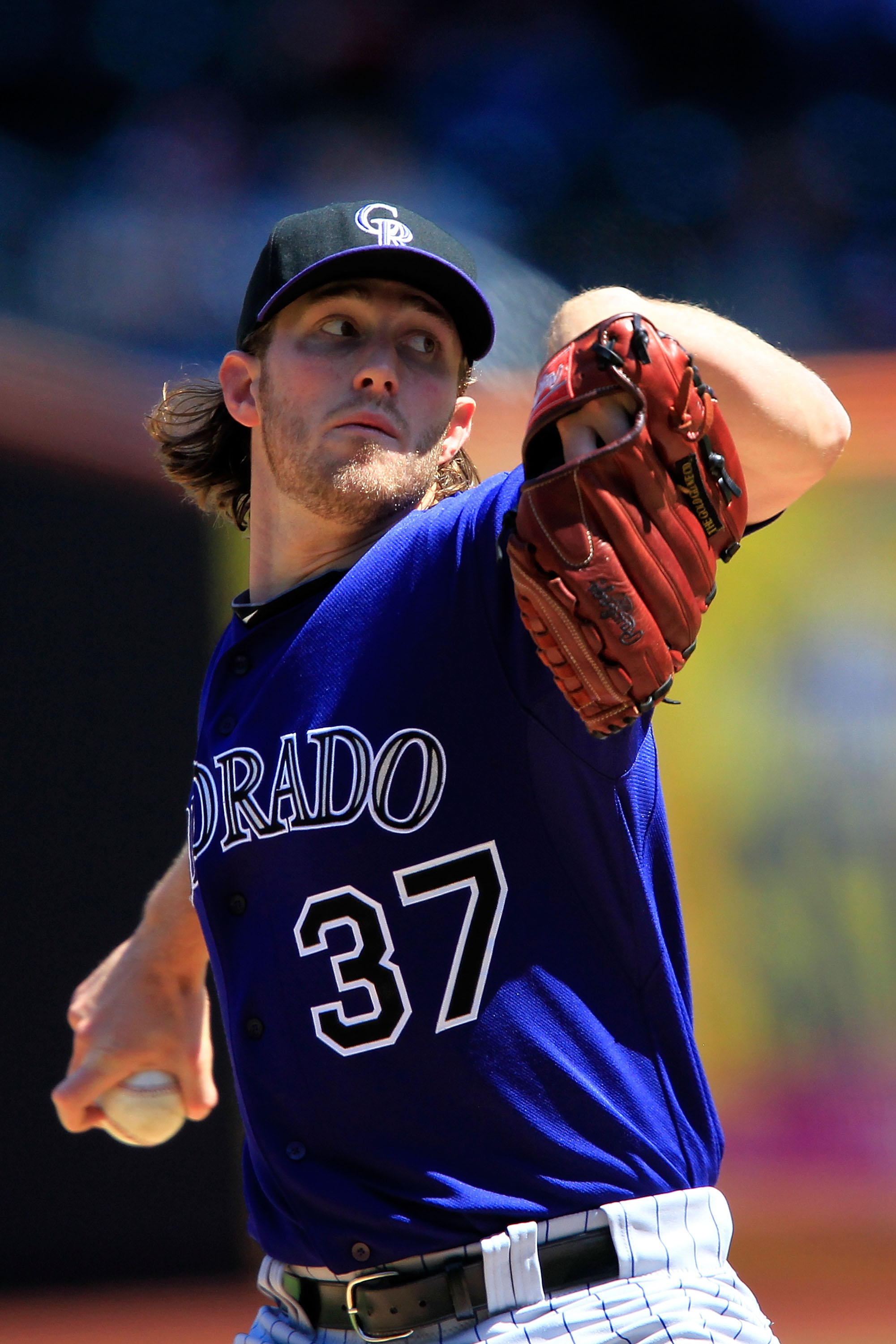 Rockies spot starter Greg Reynolds tosses a pitch in his victory against the Mets on April 14, 2011, his first MLB victory since 2008