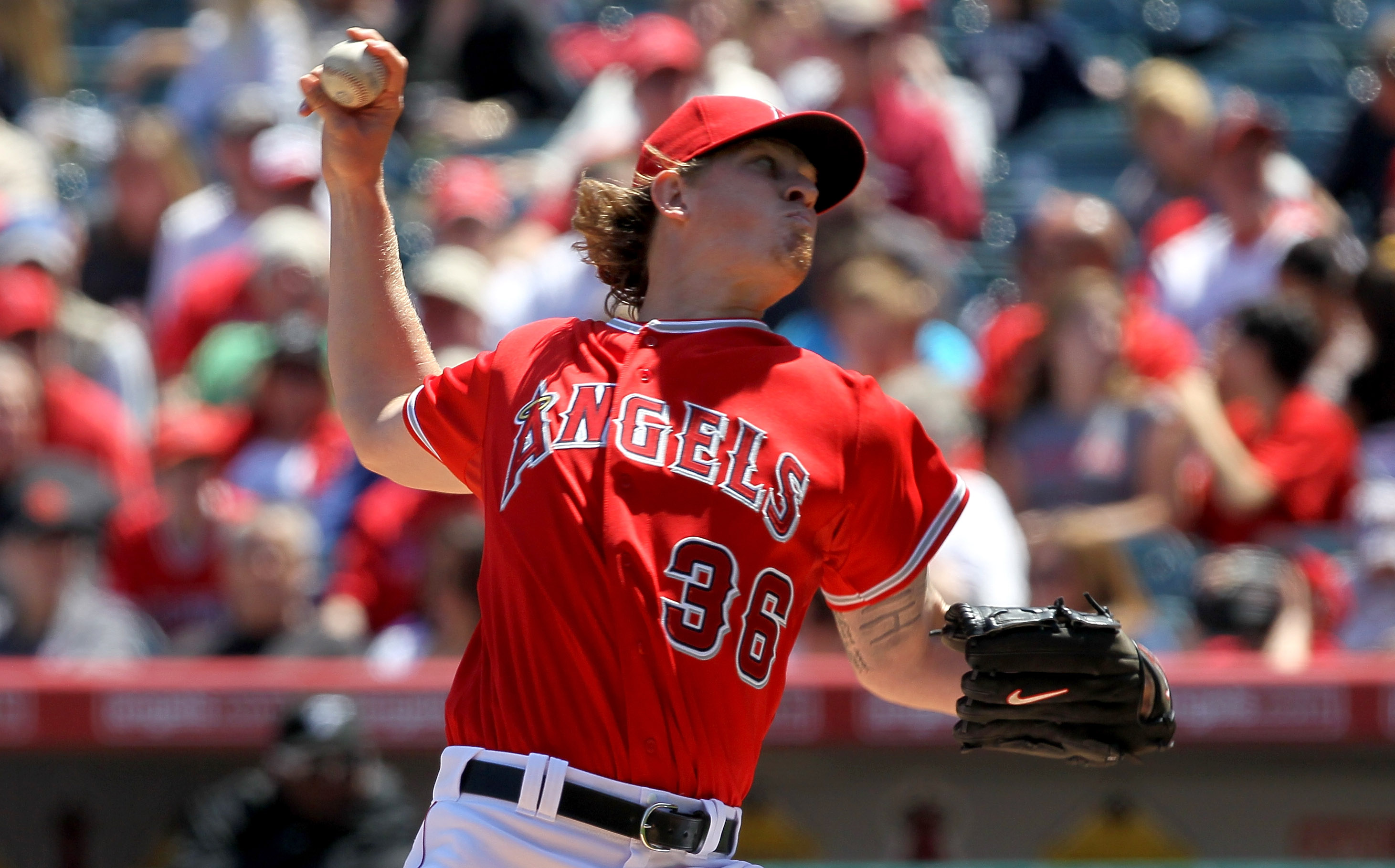 ANAHEIM, CA - APRIL 10:  Jered Weaver #36 of the Los Angeles Angels of Anaheim throws a pitch against the Toronto Blue Jays on April 10, 2011 at Angel Stadium in Anaheim, California.  (Photo by Stephen Dunn/Getty Images)