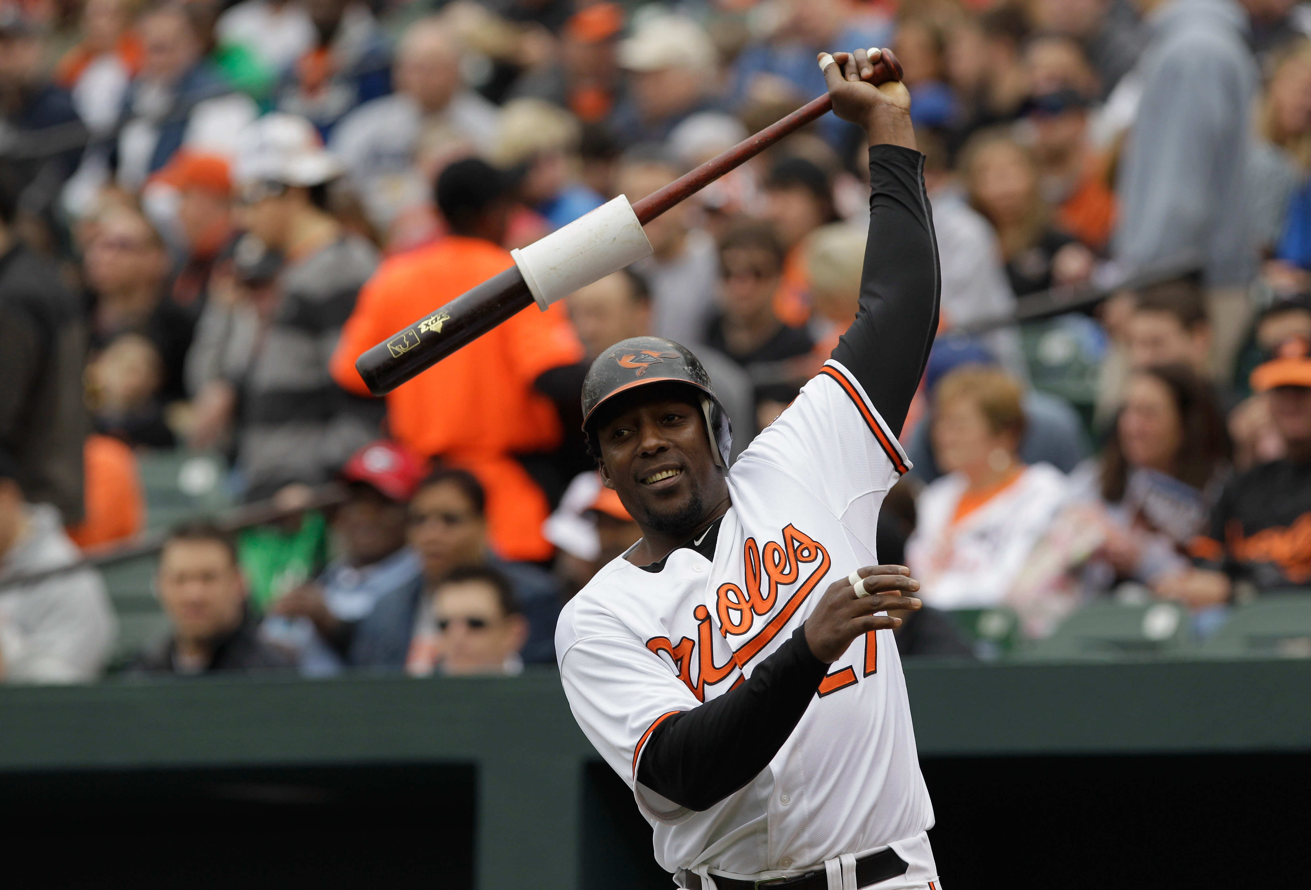 BALTIMORE, MD - APRIL 10:  Vladimir Guerrero #27 of the Baltimore Orioles in the on deck circle against the Texas Rangers at Oriole Park at Camden Yards on April 10, 2011 in Baltimore, Maryland.  (Photo by Rob Carr/Getty Images)