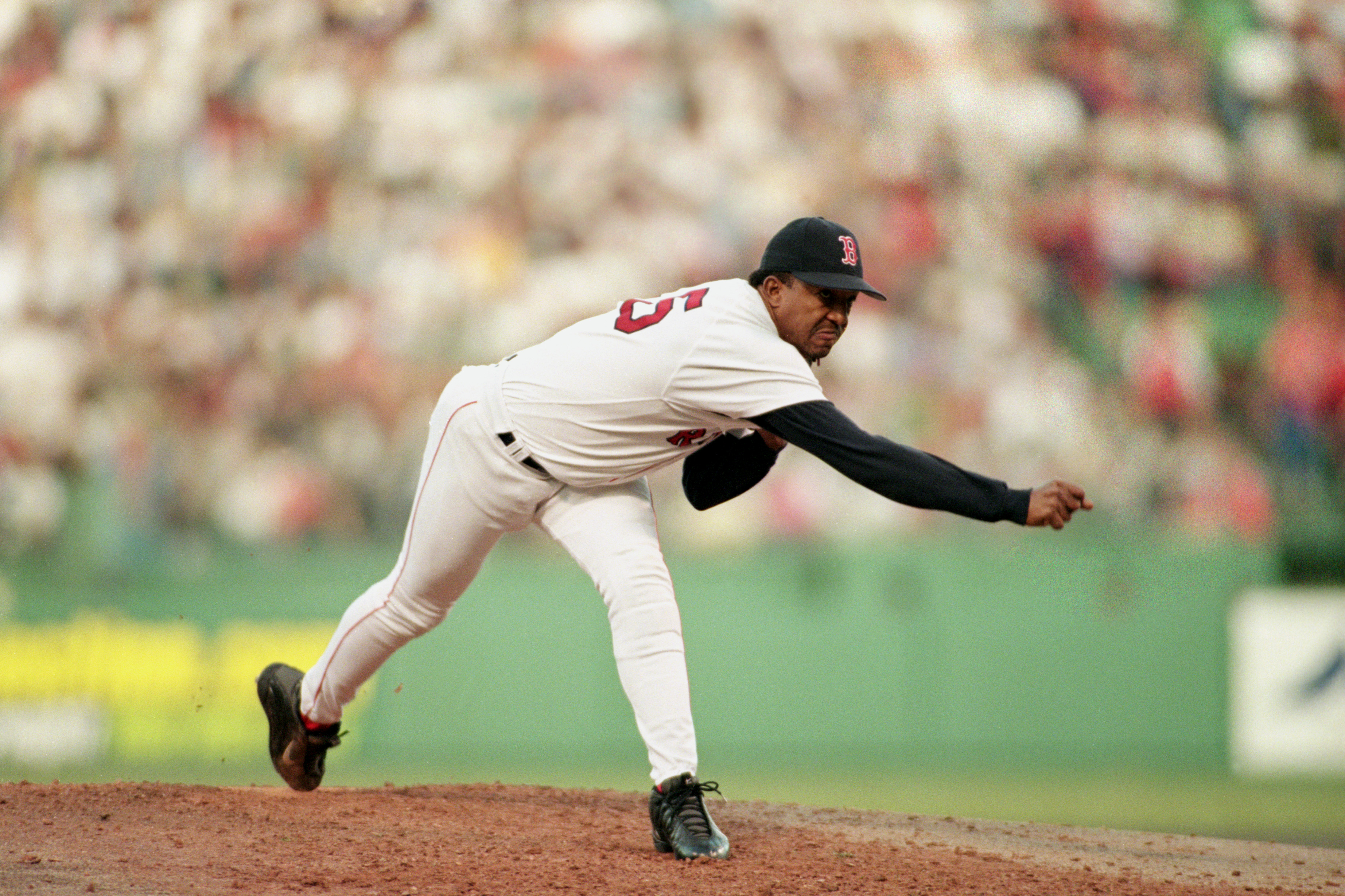BOSTON - OCTOBER 16:  Pitcher Pedro Martinez #45 of the Boston Red Sox delivers a pitch against the New York Yankees during the game at Fenway Park in Boston, Massachusetts on October 16, 1999.  The Red Sox won 13-1.  (Photo by Jed Jacobsohn/Getty Images)