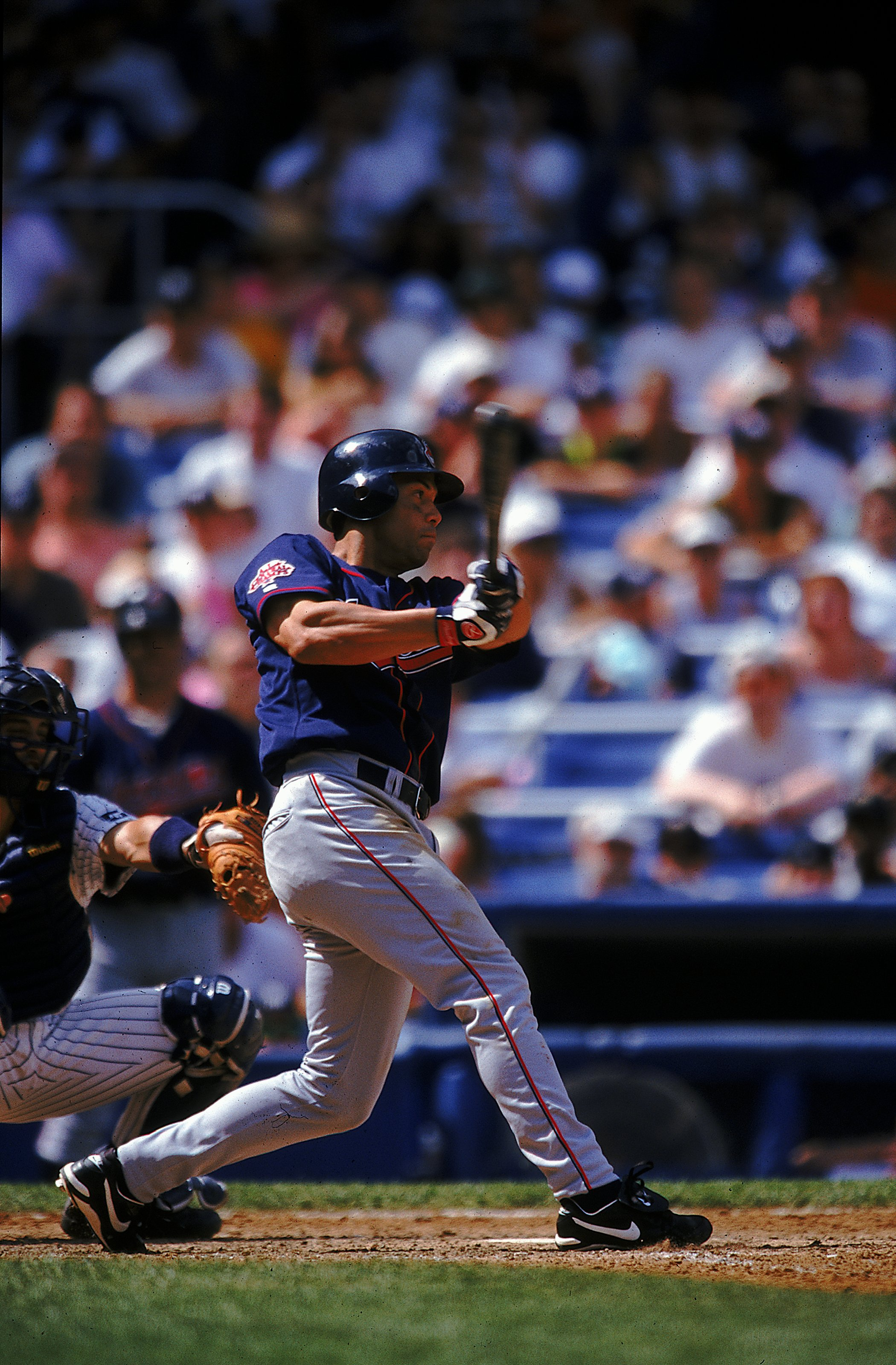 25 Jul 1999: Roberto Alomar #12 of the Cleveland Indians watches the ball after hitting it during the game against the New York Yankees at Yankee Stadium in the Bronx, New York. The Yankees defeated the Indians 2-1.
