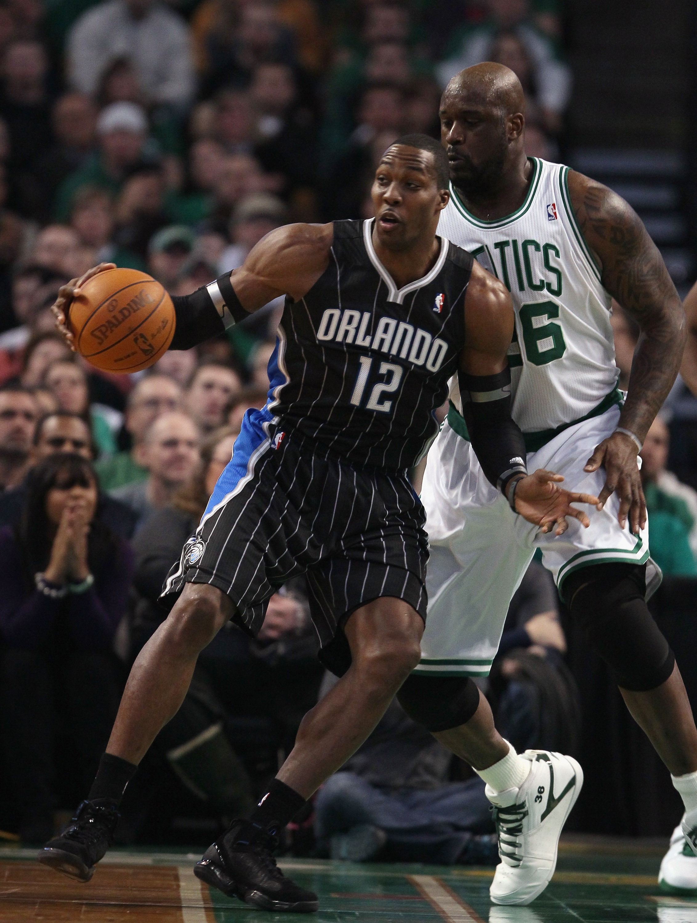 BOSTON, MA - JANUARY 17:  Dwight Howard #12 of the Orlando Magic tries to get around Shaquille O'Neal #36 of the Boston Celtics on January 17, 2011 at the TD Garden in Boston, Massachusetts.  NOTE TO USER: User expressly acknowledges and agrees that, by d