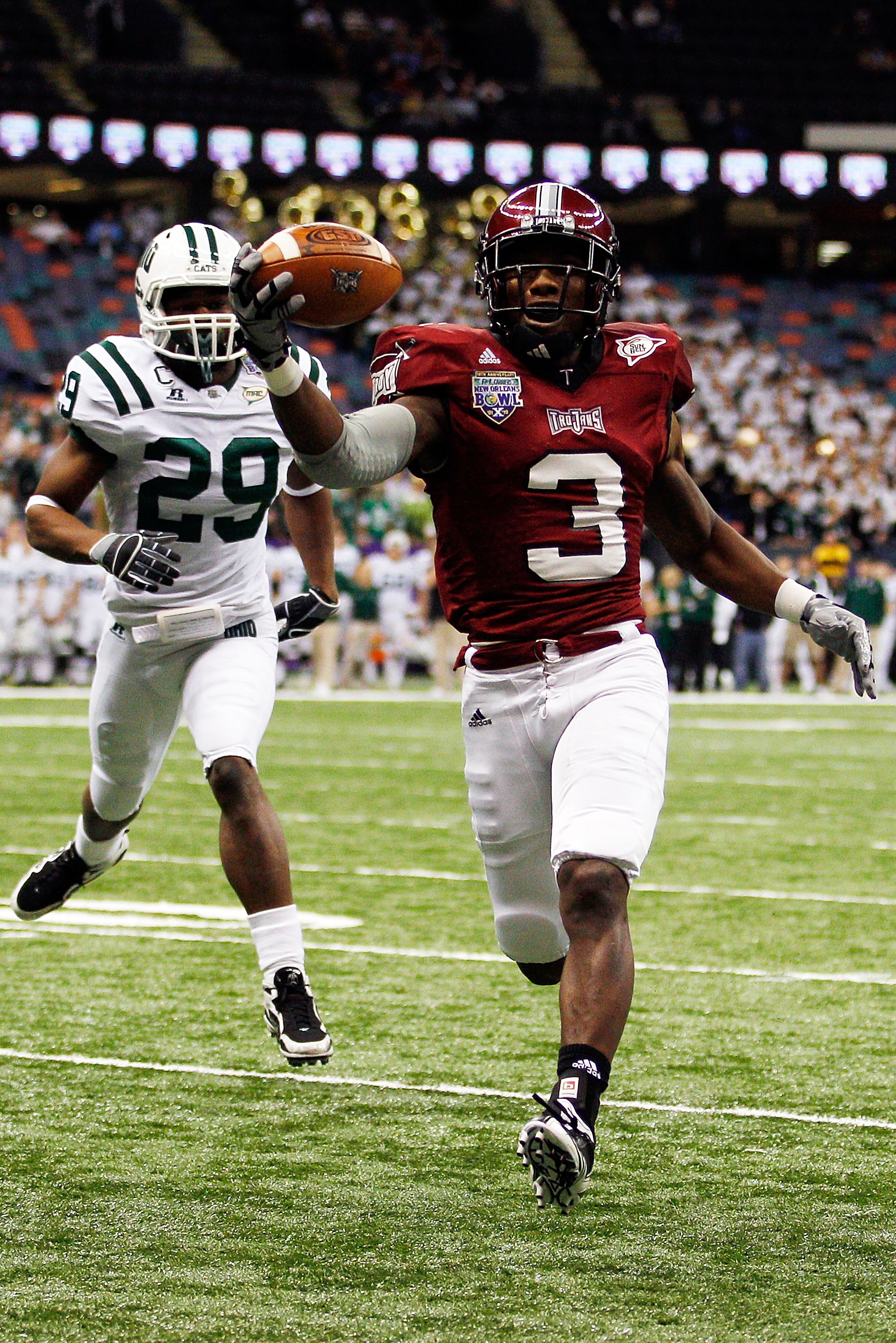 NEW ORLEANS, LA - DECEMBER 18:  Jerrel Jernigan #3 of the Troy University Trojans scores a touchdown over Donovan Fletcher #29 of the Ohio University Bobcats during the R&L Carriers New Orleans Bowl at the Louisiana Superdome on December 18, 2010 in New O