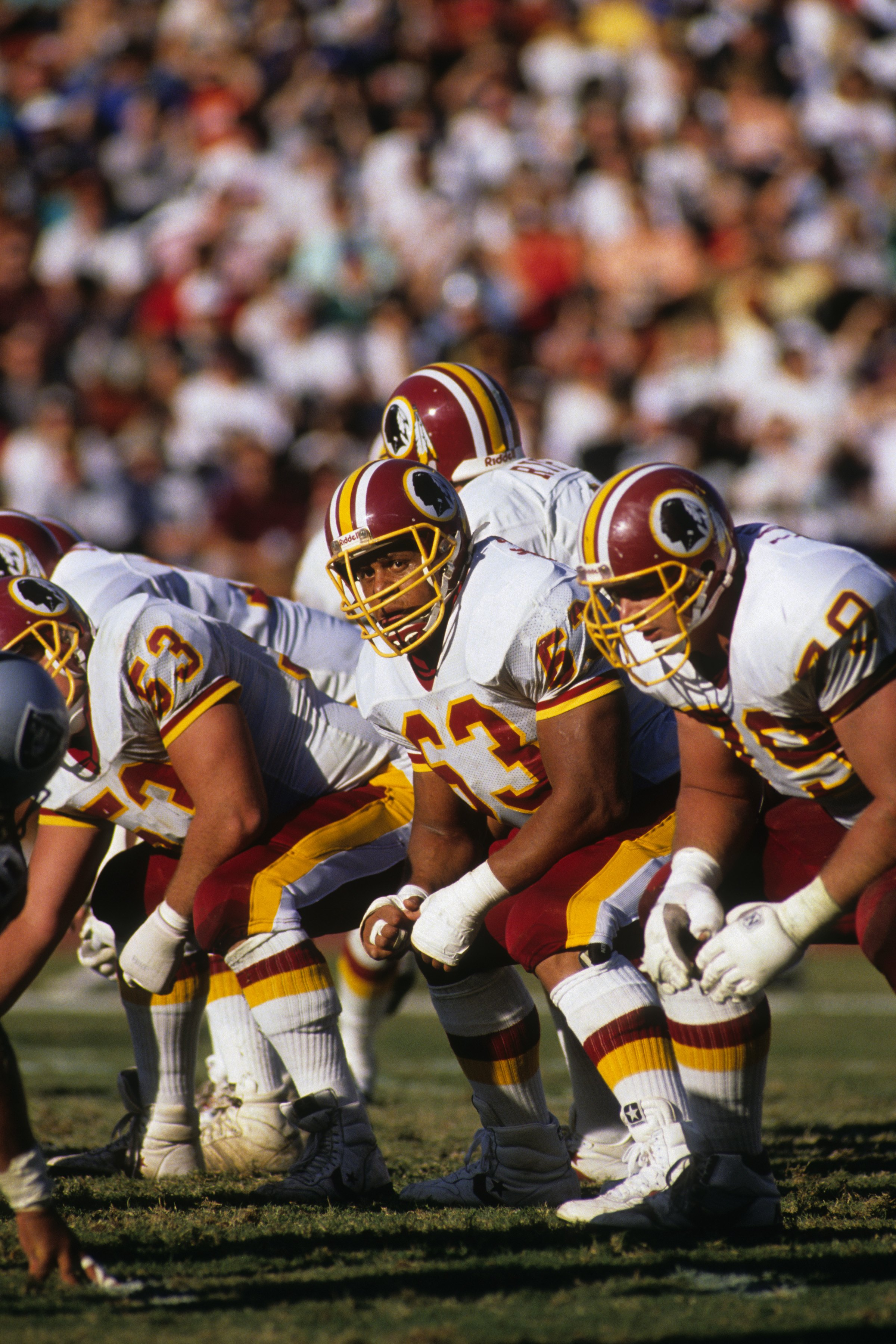 WASHINGTON - OCTOBER 29:  Tackle Raleigh McKenzie #63 of the Washington Redskins lines up on the line of scrimage during the game against the Los Angeles Raiders at RFK Stadium on October 29, 1989 in Washington, D.C.  The Raiders won 37-24.  (Photo by Geo