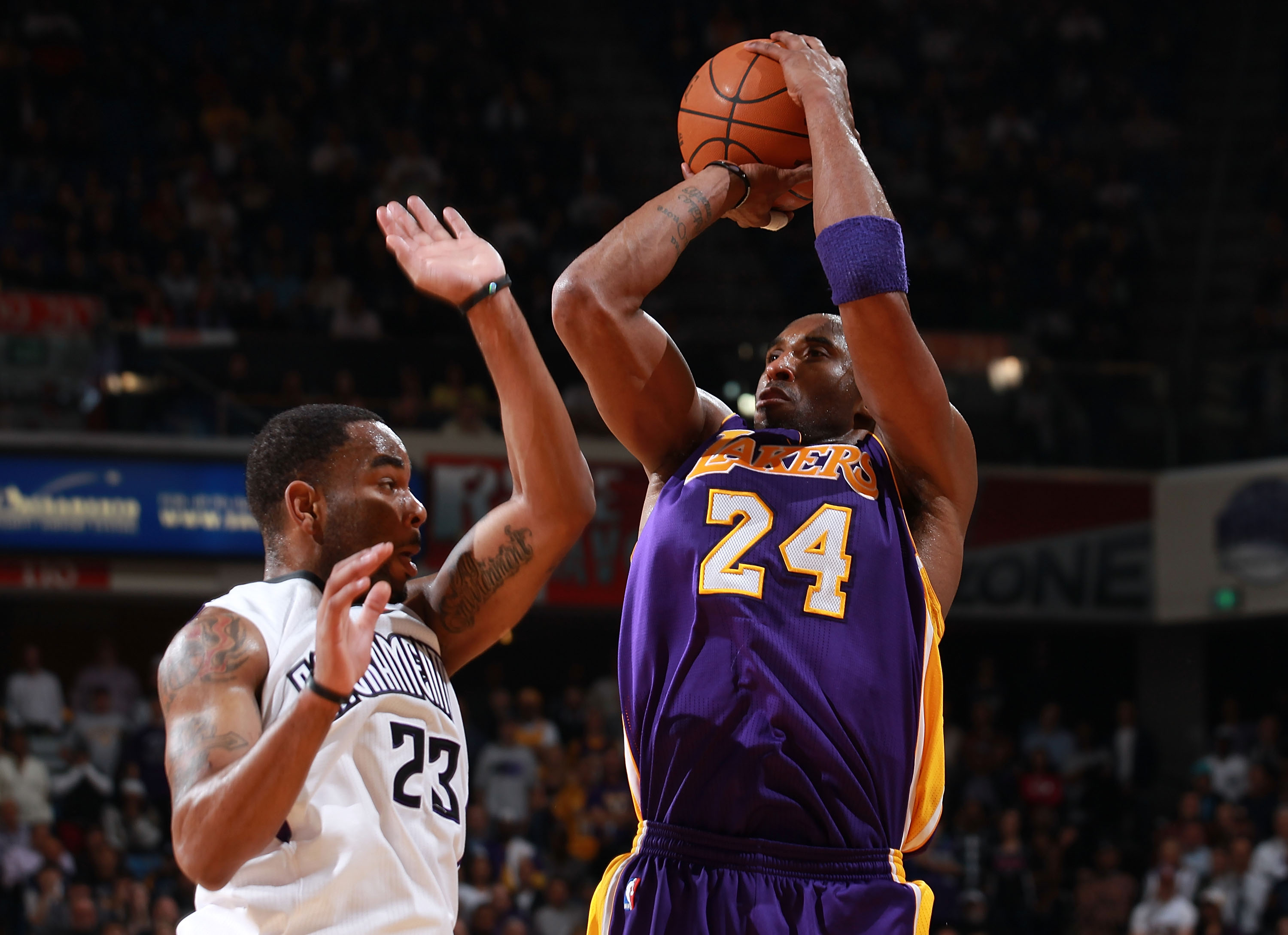 SACRAMENTO, CA - APRIL 13:  Kobe Bryant #24 of the Los Angeles Lakers shoots against Marcus Thornton #23 of the Sacramento Kings look on against  on April 13, 2011 at Power Balence Pavilion in Sacramento, California. NOTE TO USER: User expressly acknowled