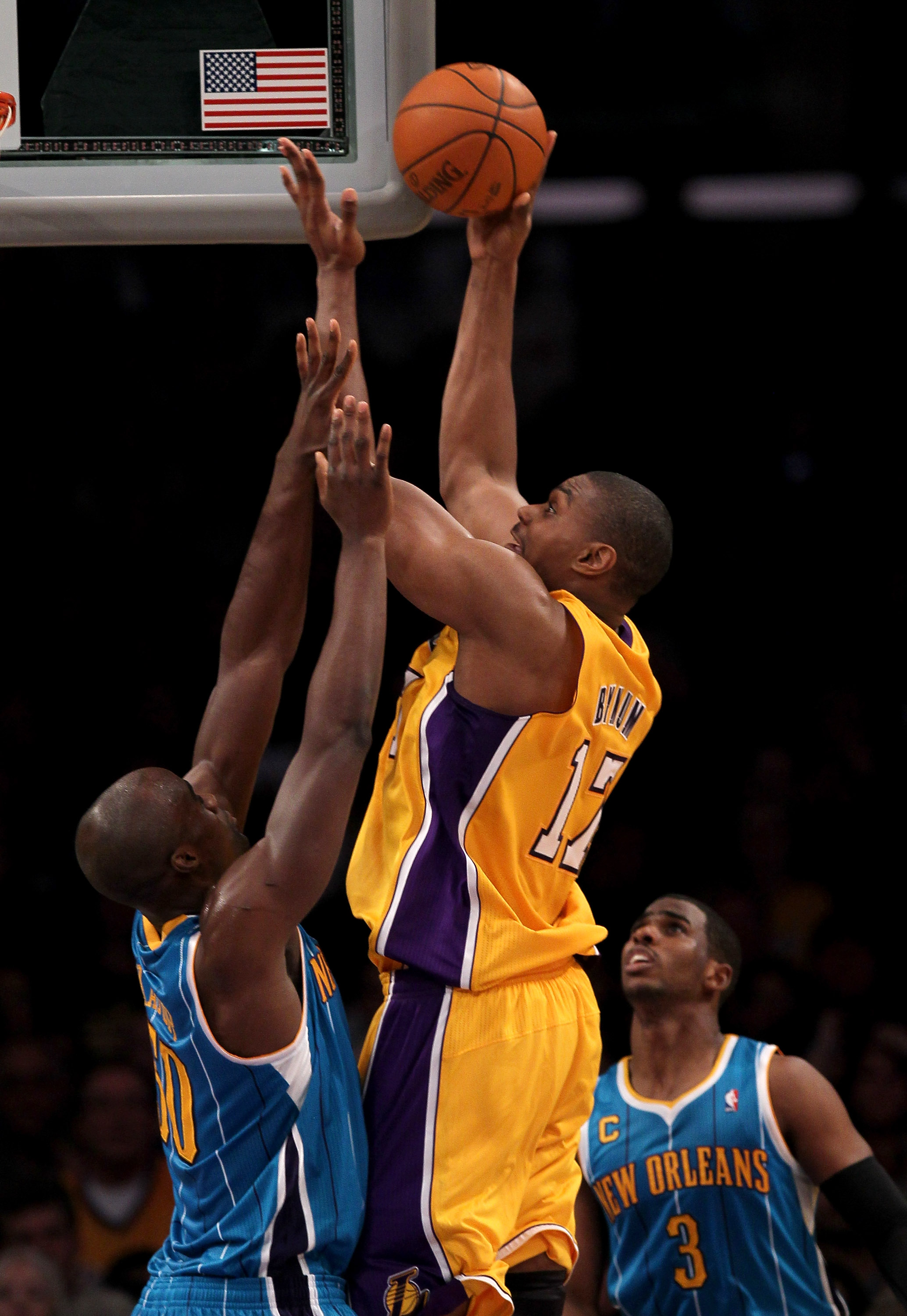 LOS ANGELES, CA - JANUARY 07:  Andrew Bynum #17 of the Los Angeles Lakers shoots over Emeka Okafor #50 of the New Orleans Hornets at Staples Center on January 7, 2011 in Los Angeles, California. The Lakers won 101-97.  NOTE TO USER: User expressly acknowl