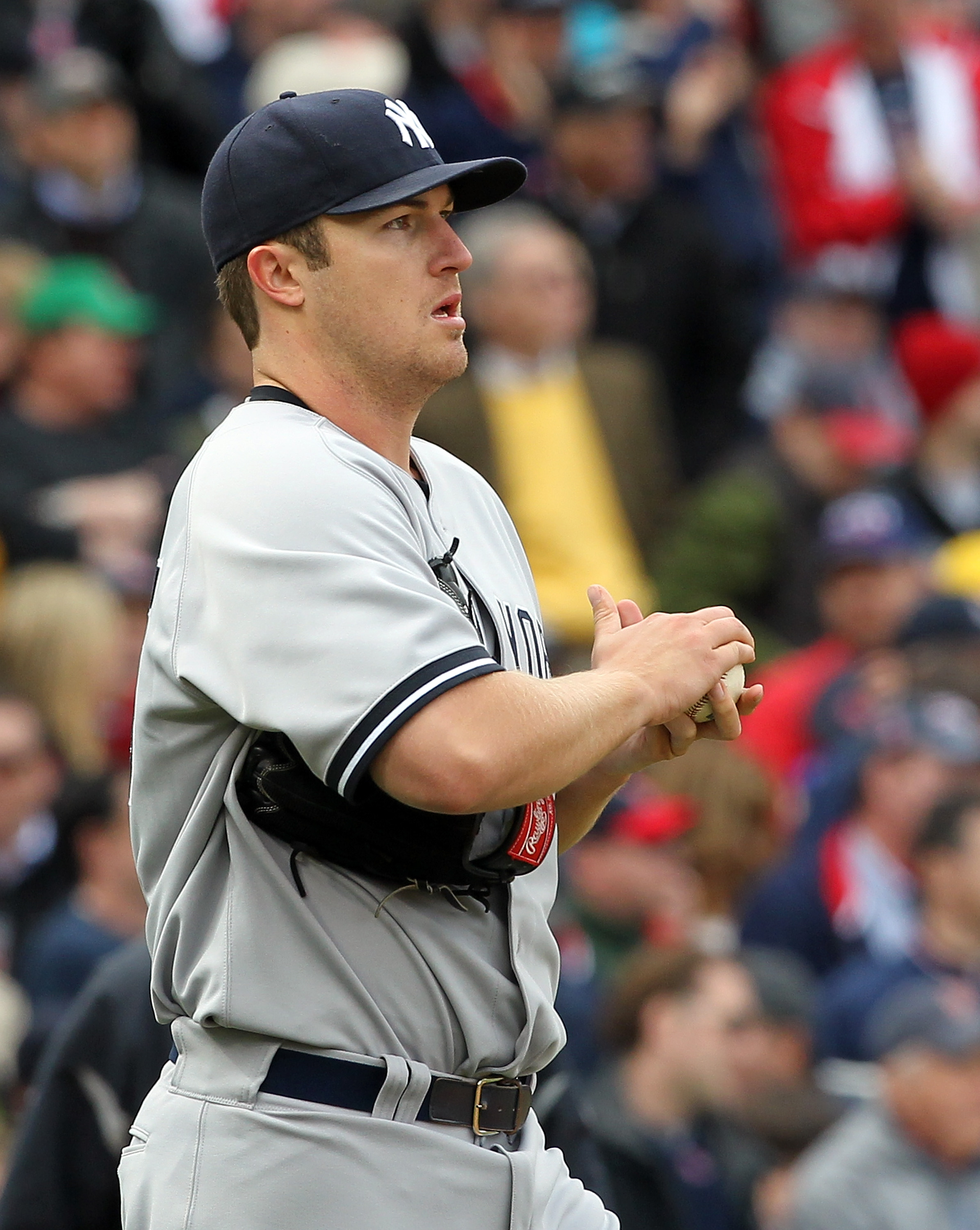 BOSTON, MA - APRIL 8:  Phil Hughes #65 of  the New York Yankees reacts during a rough second inning against the Boston Red Sox on Opening Day at Fenway Park on April 8, 2011 in Boston, Massachusetts. (Photo by Jim Rogash/Getty Images)