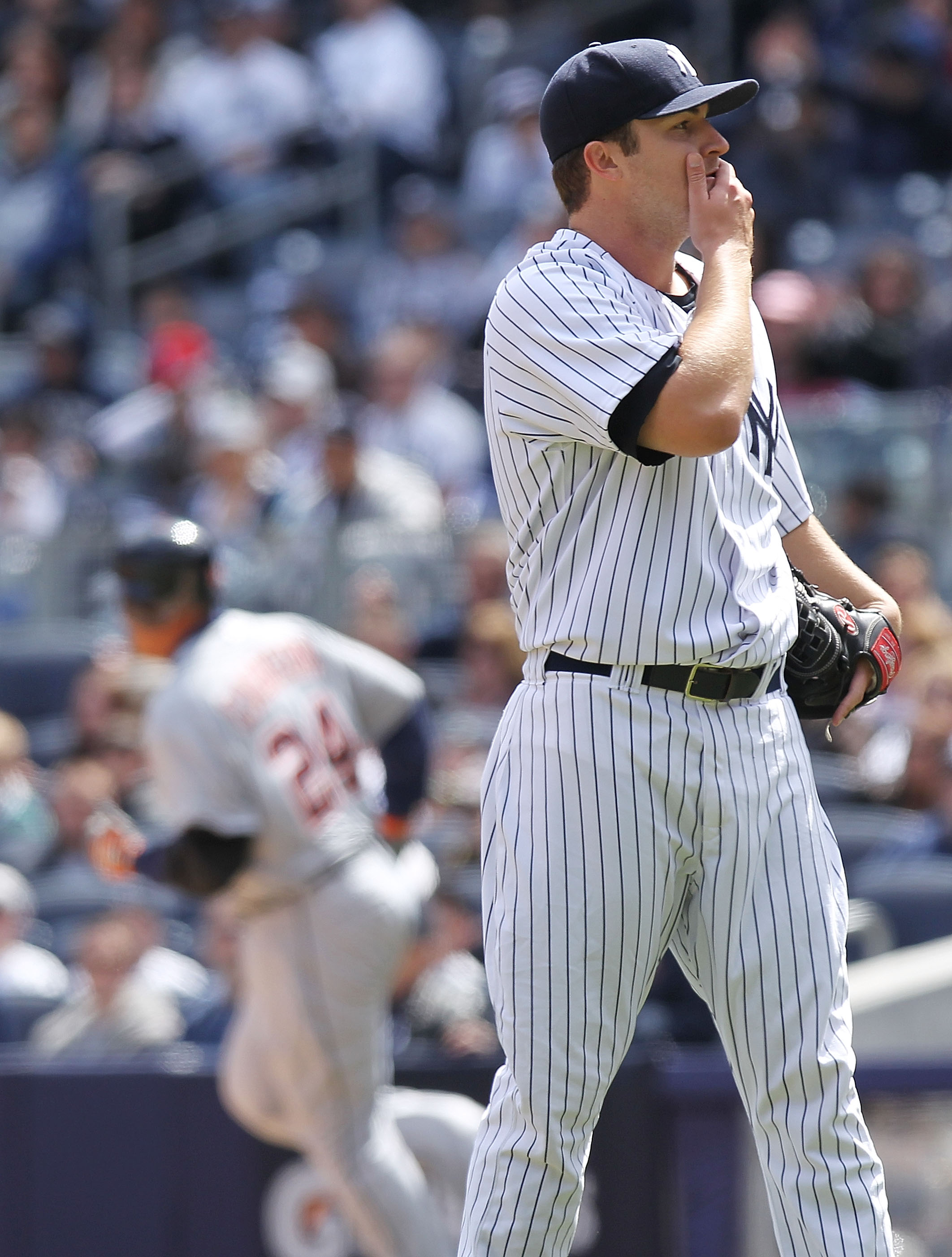 NEW YORK, NY - APRIL 03:  Phil Hughes #65 of the New York Yankees reacts after Miguel Cabrera #24 of the Detroit Tigers rounds the bases on a two run home run at Yankee Stadium on April 3, 2011 in the Bronx borough of New York City.  (Photo by Nick Laham/