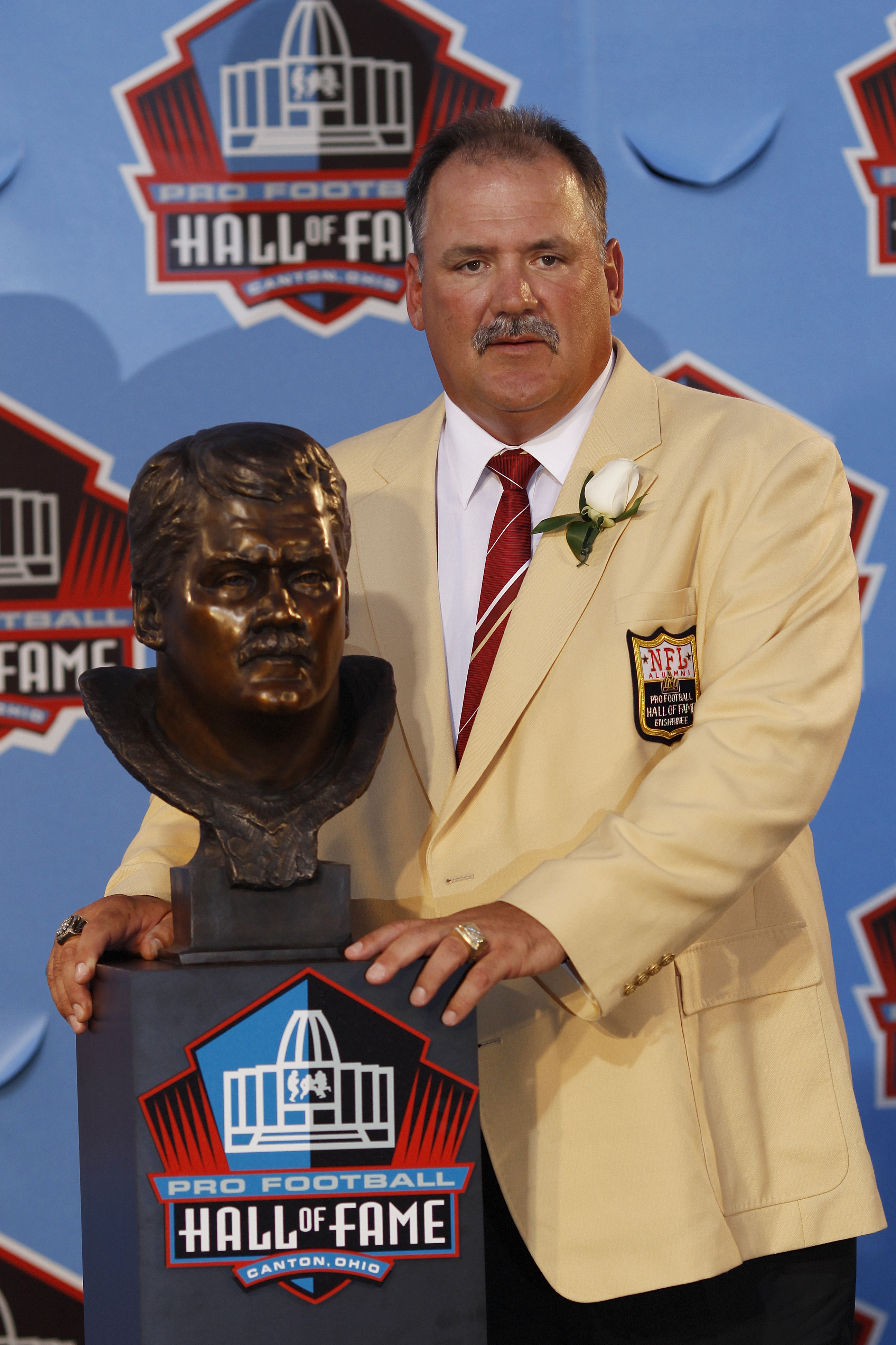 CANTON, OH - AUGUST 7: Russ Grimm poses with his bust during the 2010 Pro Football Hall of Fame Enshrinement Ceremony at the Pro Football Hall of Fame Field at Fawcett Stadium on August 7, 2010 in Canton, Ohio. (Photo by Joe Robbins/Getty Images)